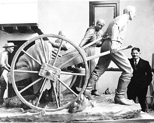 """Torleif Knaphus is shown with """"Handcart Pioneers"""" sculpture he designed, which eventually became a famous Temple Square statue. A casting from original work is being sent to Norway, his homeland."""