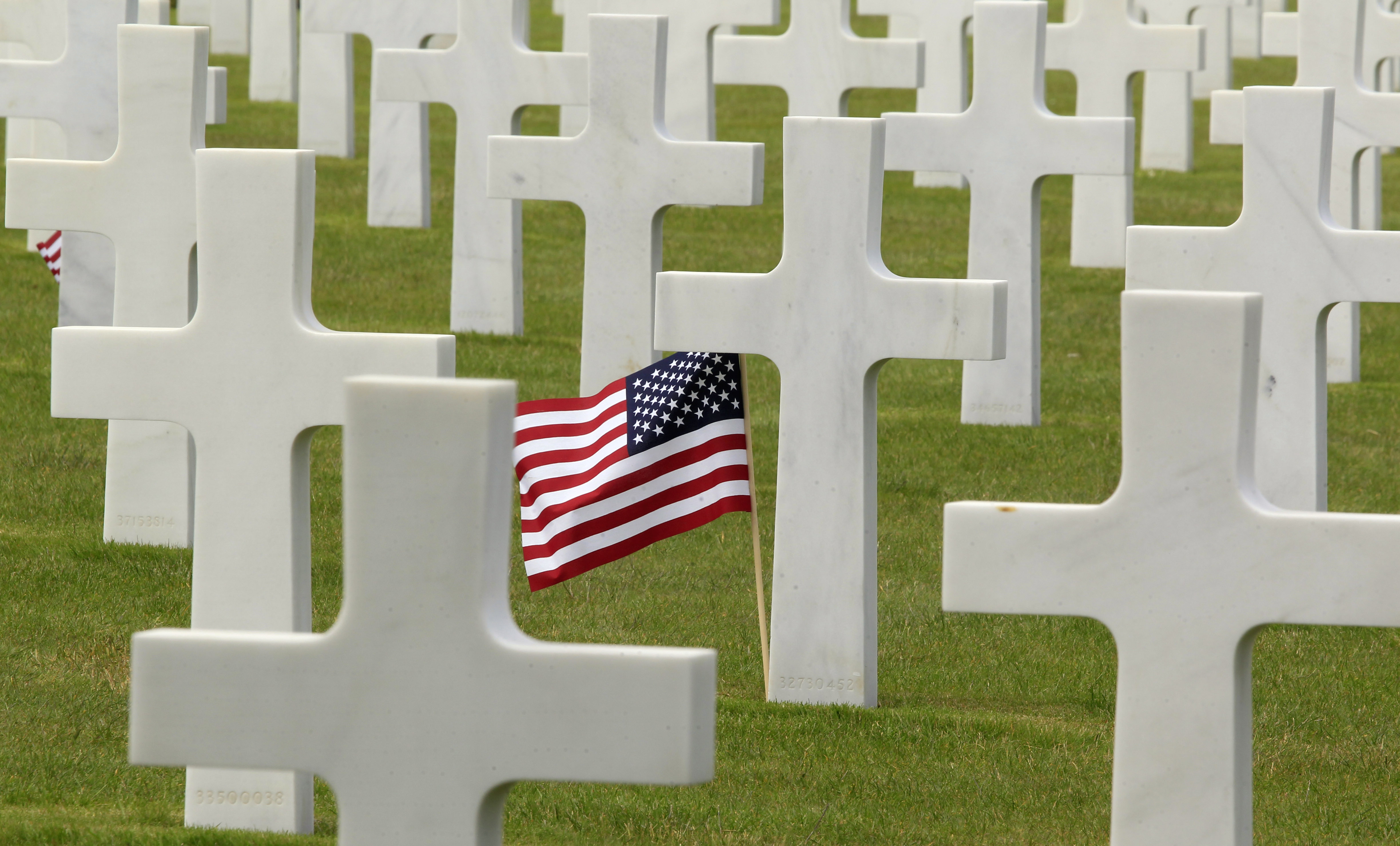 A U.S. flag flies among the graves at the Colleville American military cemetery, in Colleville sur Mer, western France, Thursday June 6, 2013, on the day of the commemoration of the 69th anniversary of the D-Day.(AP Photo/Remy de la Mauviniere)