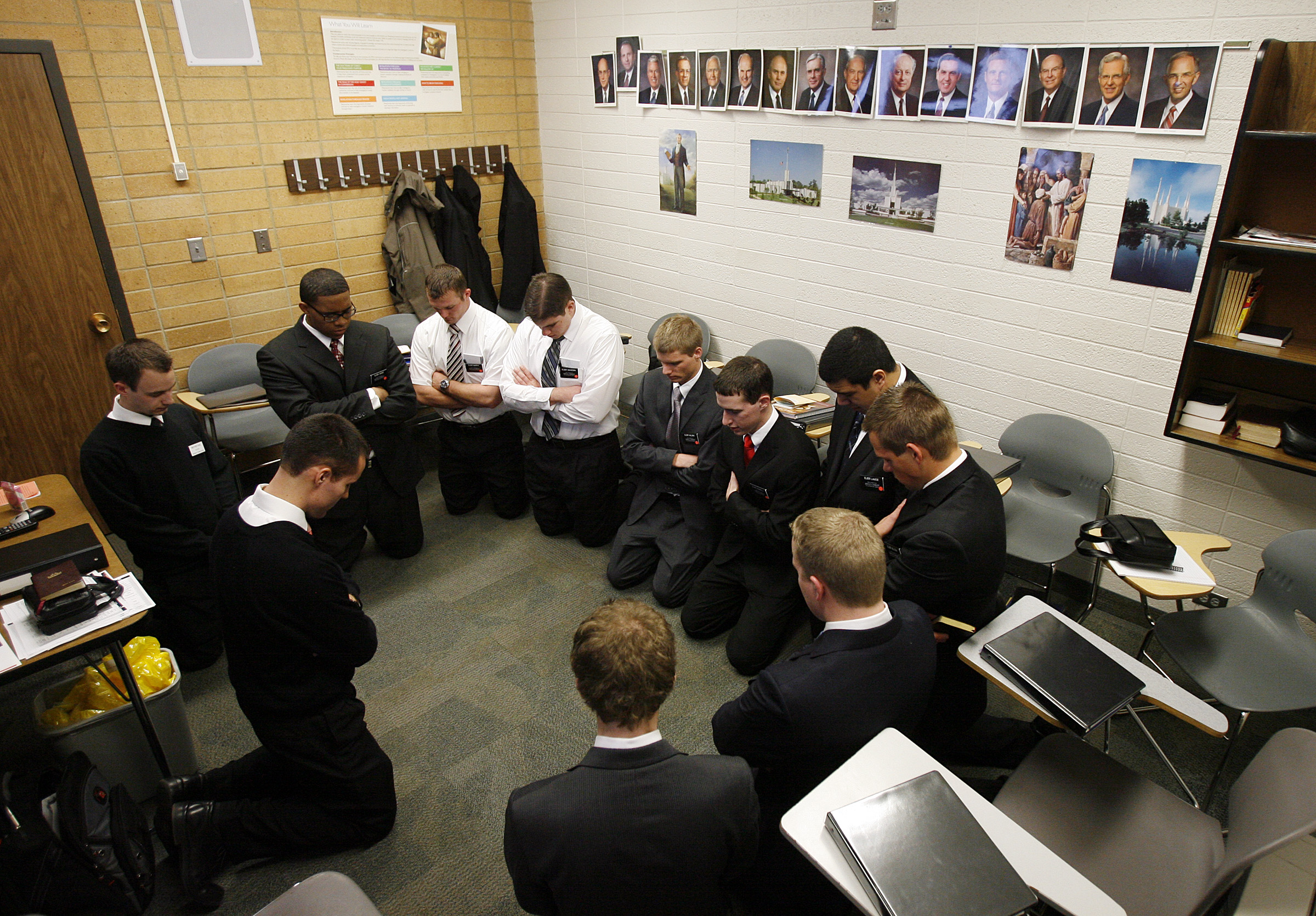 Missionaries begin their class with prayer on their first day at the Provo Missionary Training Center in one of the MTC's training buildings in Provo, Utah, Wednesday, Feb. 2, 2011.