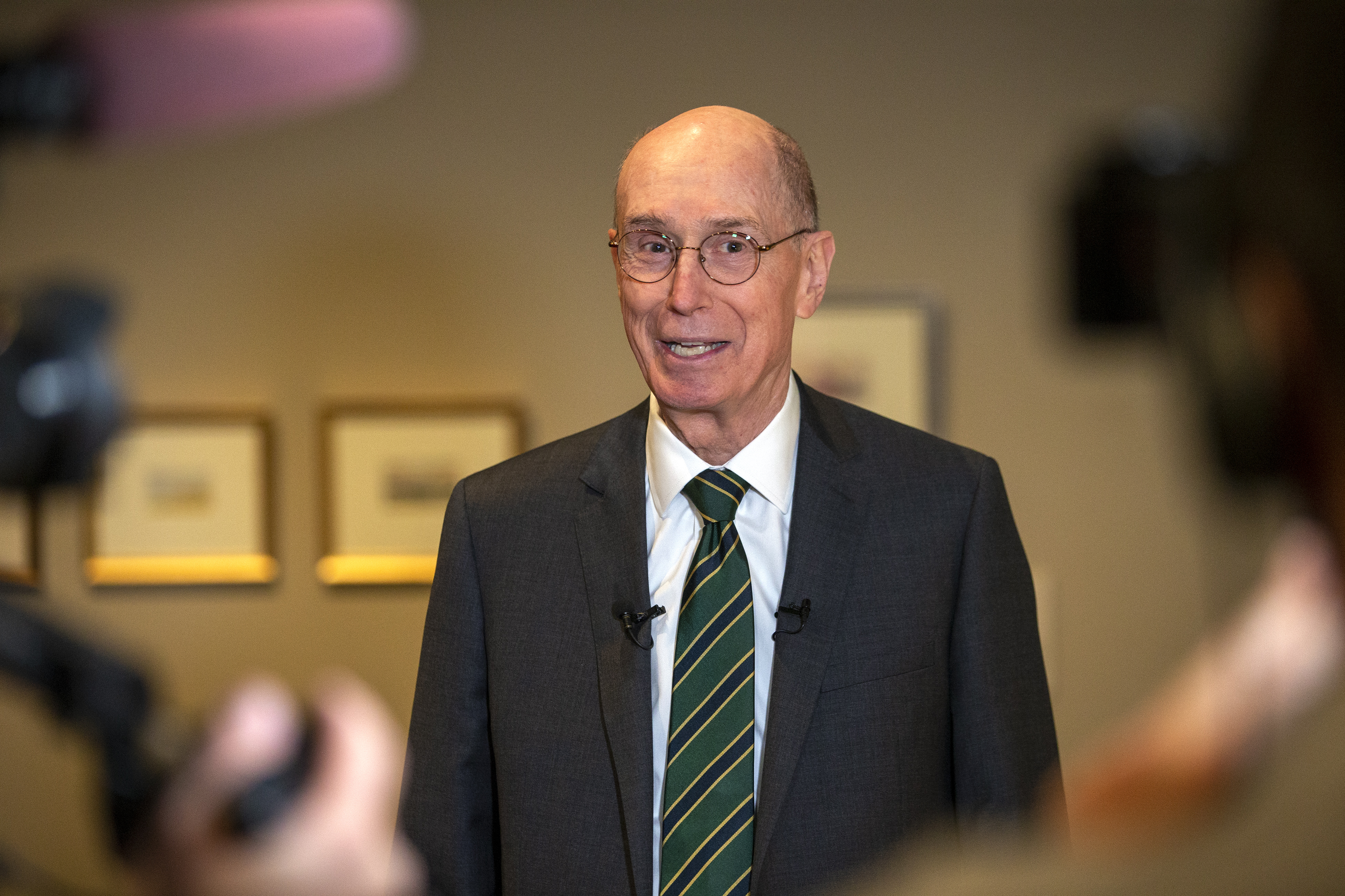 President Henry B. Eyring discusses the different pieces of his art on display in a special exhibit at the Church History Museum in Salt Lake City.
