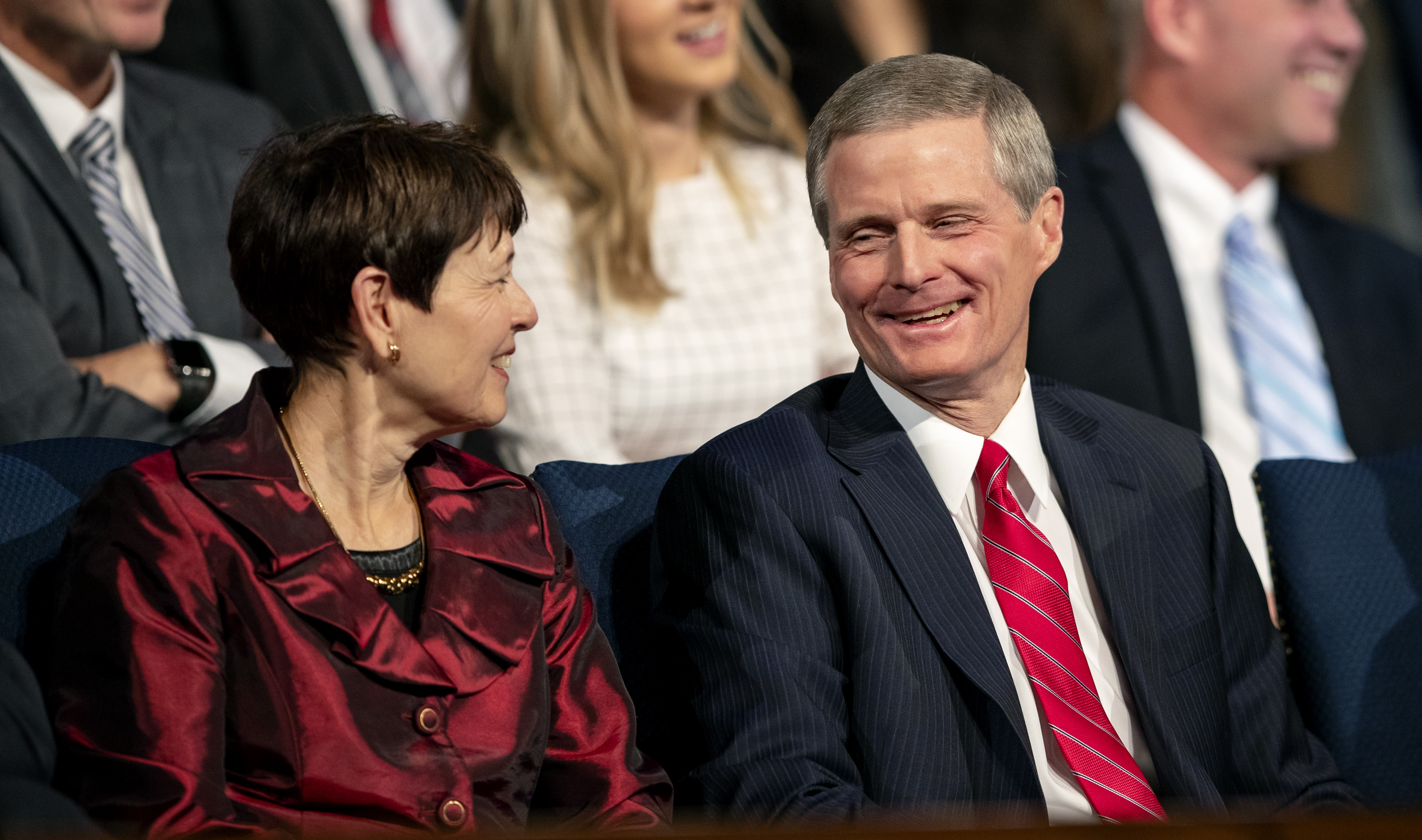 Elder David A. Bednar of the Quorum of the Twelve Apostles of and his wife, Sister Susan Bednar, share a laugh as they attend the campus devotional in the Marriott Center at BYU in Provo on Tuesday, Dec. 4, 2018.