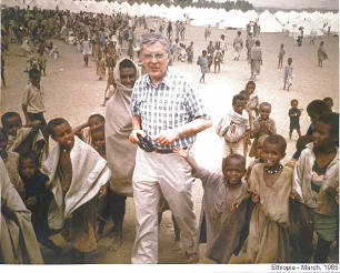 Children gathered around Elder M. Russell Ballard, then of the Presidency of the Seventy, during his visit to Ethiopia in 1985 to determine how to best utilize more than $6 million raised during a special Jan. 27, 1985, fast.