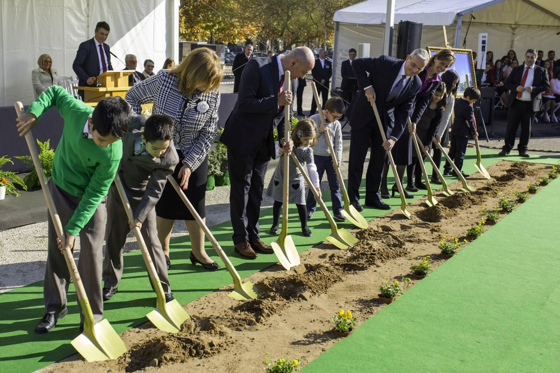 Children join other church members and leaders to break ground as part of the Lisbon Portugal Temple groundbreaking.