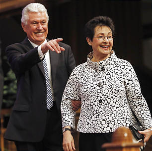President Dieter F. Uchtdorf and Sister Harriet Uchtdorf walk onto the stand prior to speaking Sunday, Feb. 9, 2014 at a devotional for Bountiful Utah Temple workers inside the Tabernacle on Temple Square.
