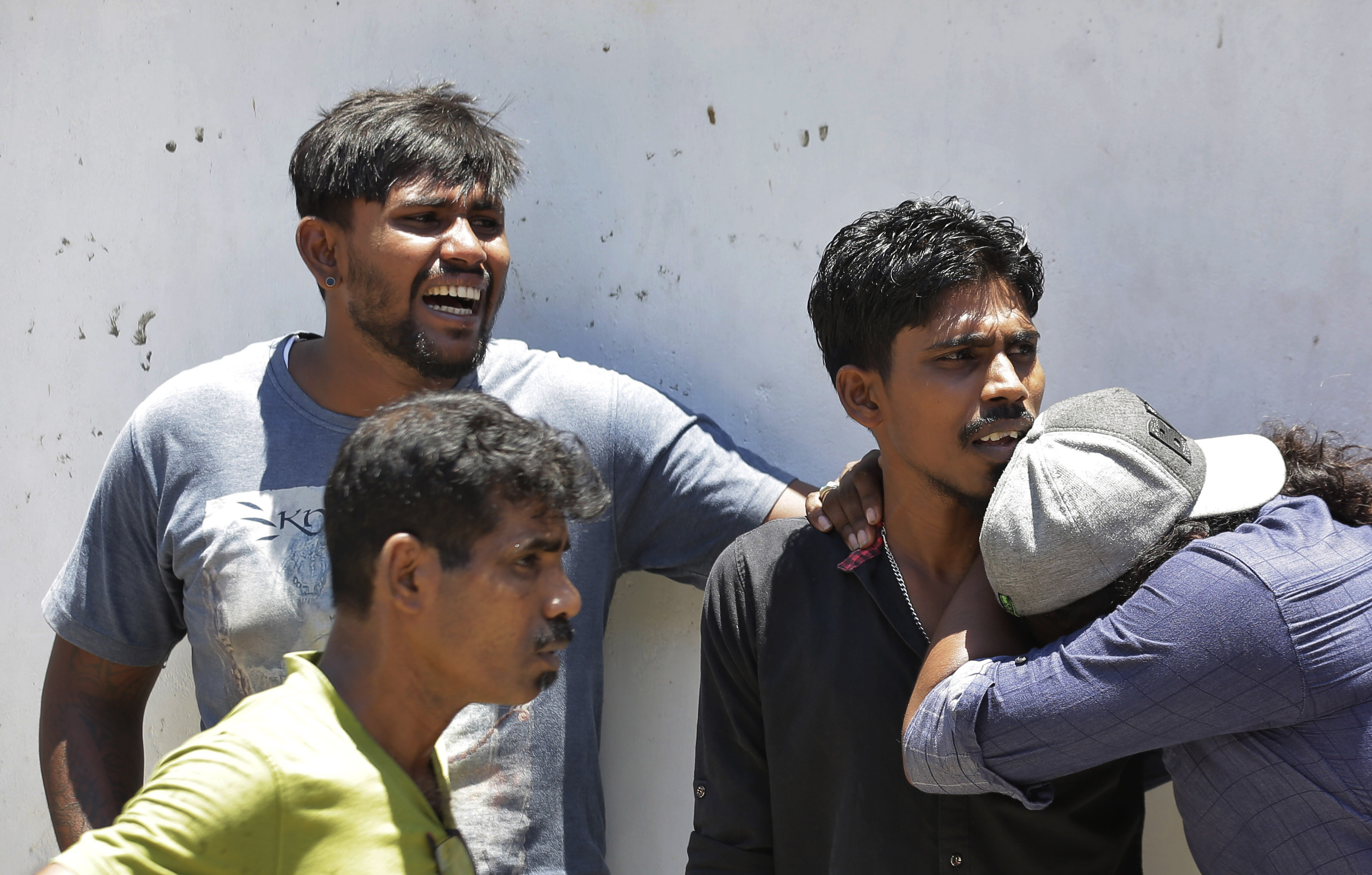 Relatives of a blast victim weep outside a police morgue in Colombo, Sri Lanka, Sunday, April 21, 2019. More than two hundred people were killed and hundreds more injured in eight blasts that rocked churches and hotels in and just outside Sri Lanka's capital on Easter Sunday.