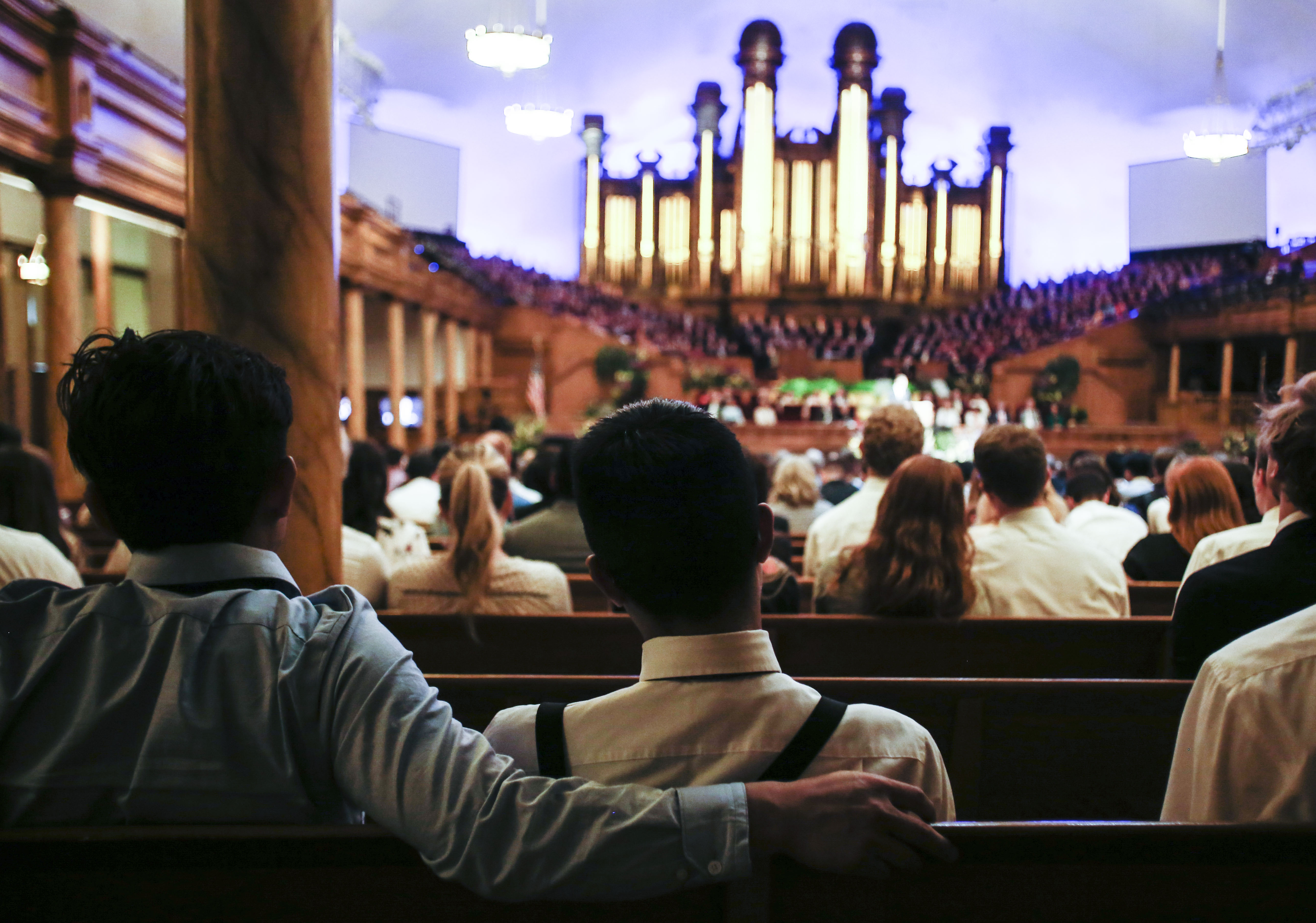 Attendees listen to Elder Carl B. Cook speak about marriage during the Worldwide Devotional for Young Adults at the Salt Lake Tabernacle in Salt Lake City on Sunday, May 5, 2019.