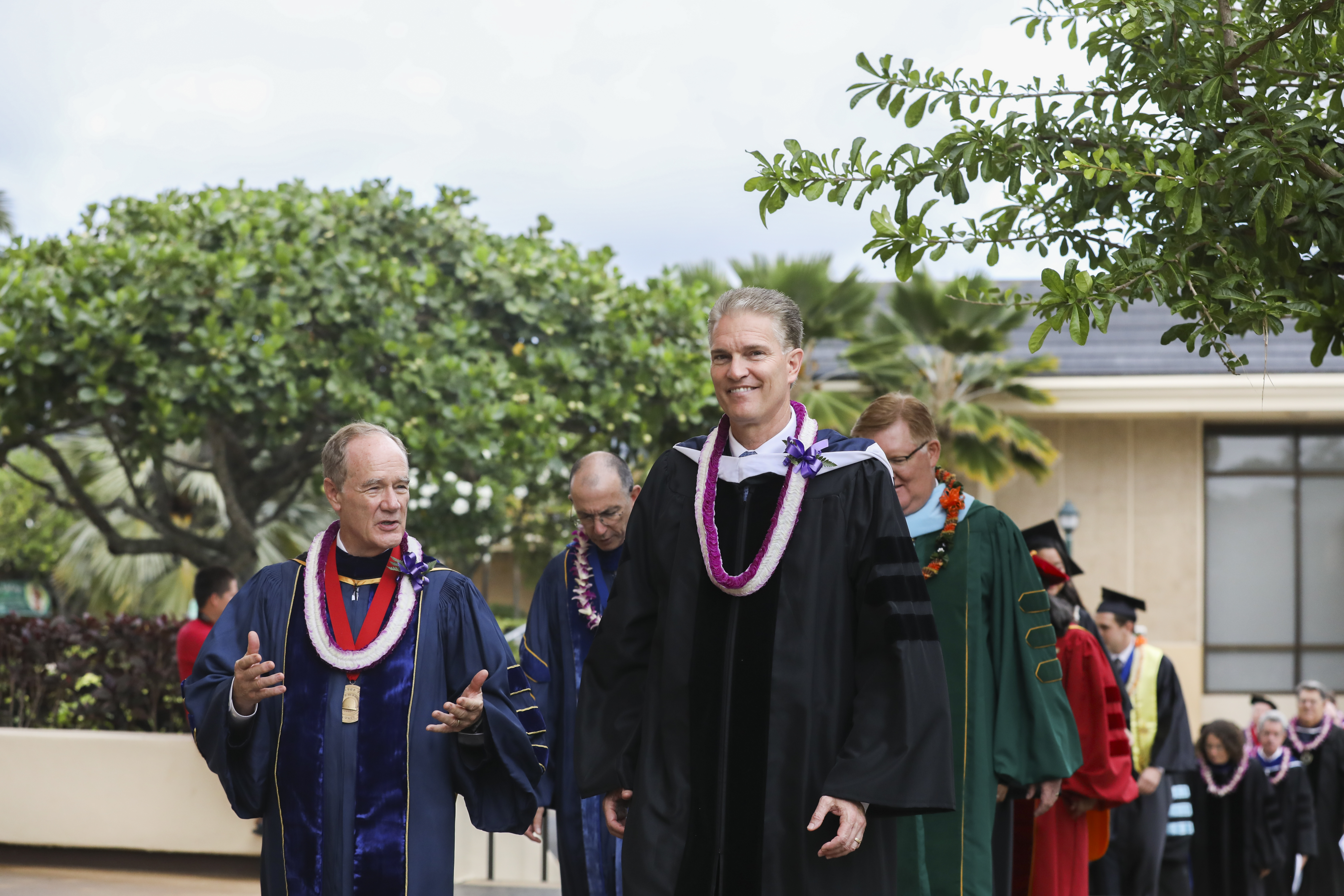 Elder Brian K. Taylor, a General Authority Seventy, walks with Brigham Young University-Hawaii President John S. Tanner and other faculty and staff at commencement on June 29, 2019.