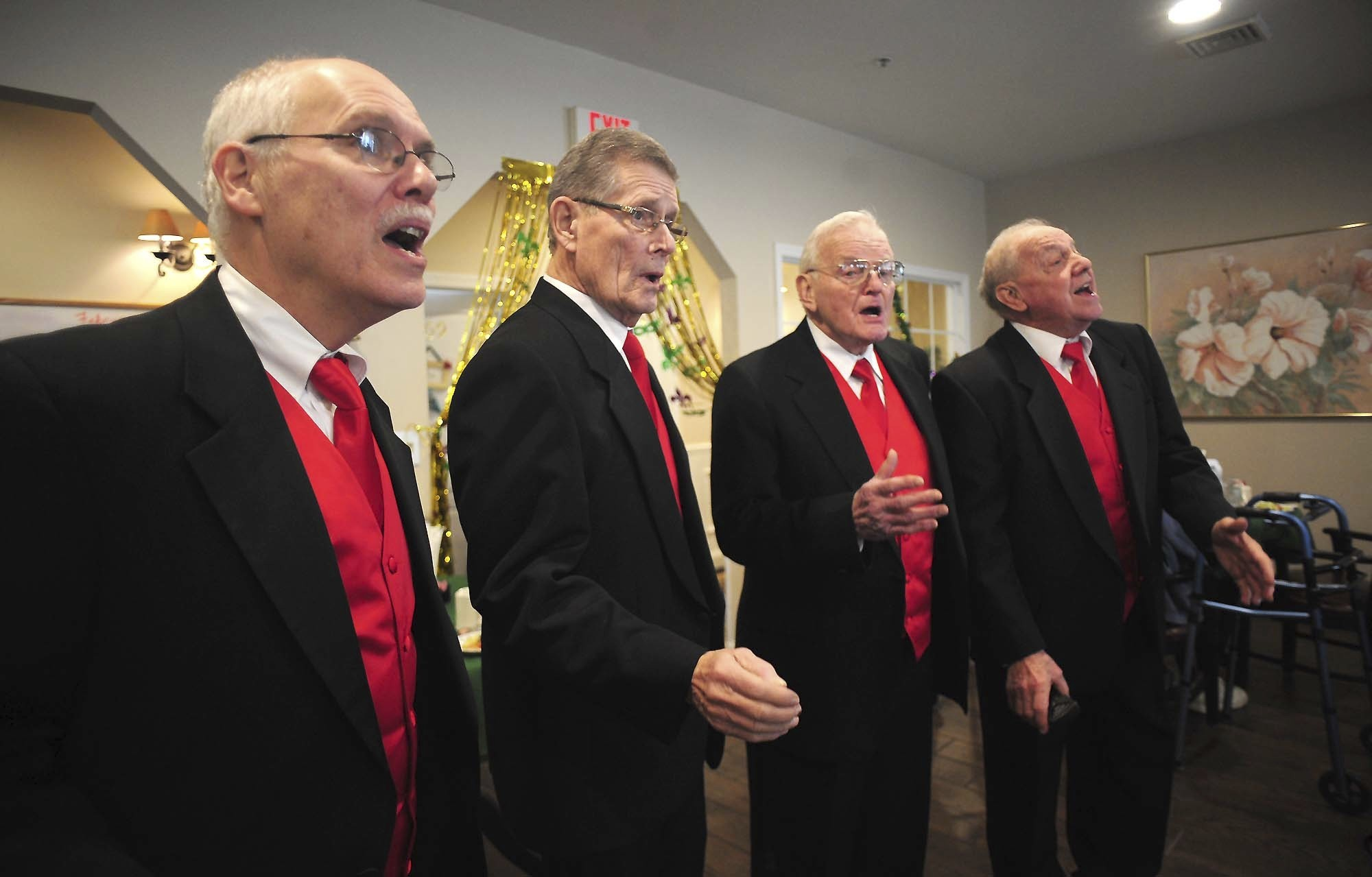 Wyoming Valley Barbershop Quartet singers, from the left; Steve Mansour, Ralph Gillespie. Ted Rebennack and Phil Brown, sing Valentines Day songs for residents at Village At Greenbriar Assisted living facility, in Dallas, Pa., Wednesday Feb.14, 2018. (Mark Moran/The Citizens' Voice via AP)