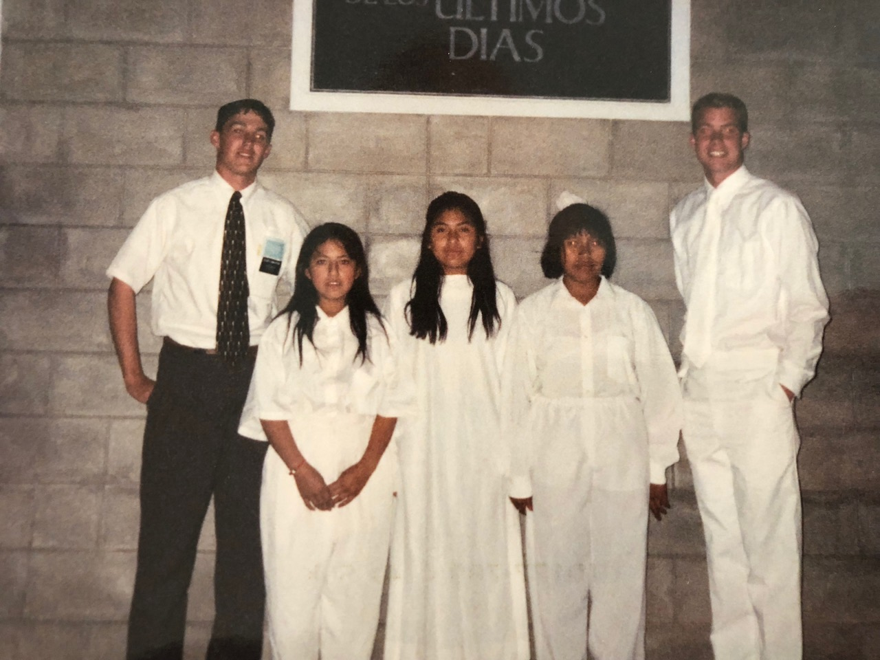 Davis Smith, right, and his companion Elder Kevin Lancaster, left, at a baptism 20 years ago. Ilsen, second left, and her sister were the first in their family to decide to get baptized. In recent visits to Bolivia, Smith has been able to reunite with Ilsen.