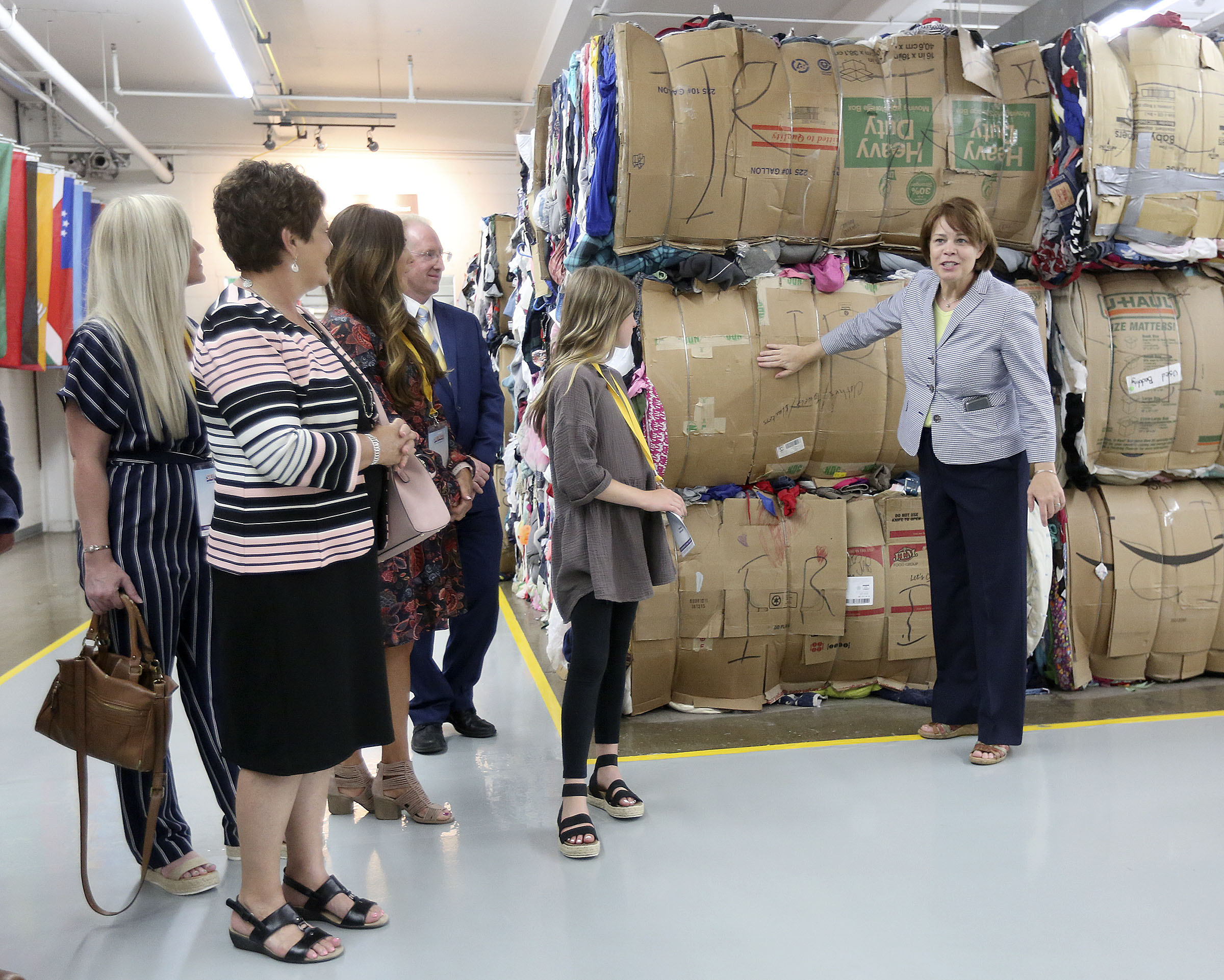 Sister Sharon Eubank, first counselor in the Relief Society general presidency, gives spouses of U.S. governors a tour of the facilities and talks about clothing donation at the Latter-day Saint Humanitarian Center in Salt Lake City on Thursday, July 25, 2019.