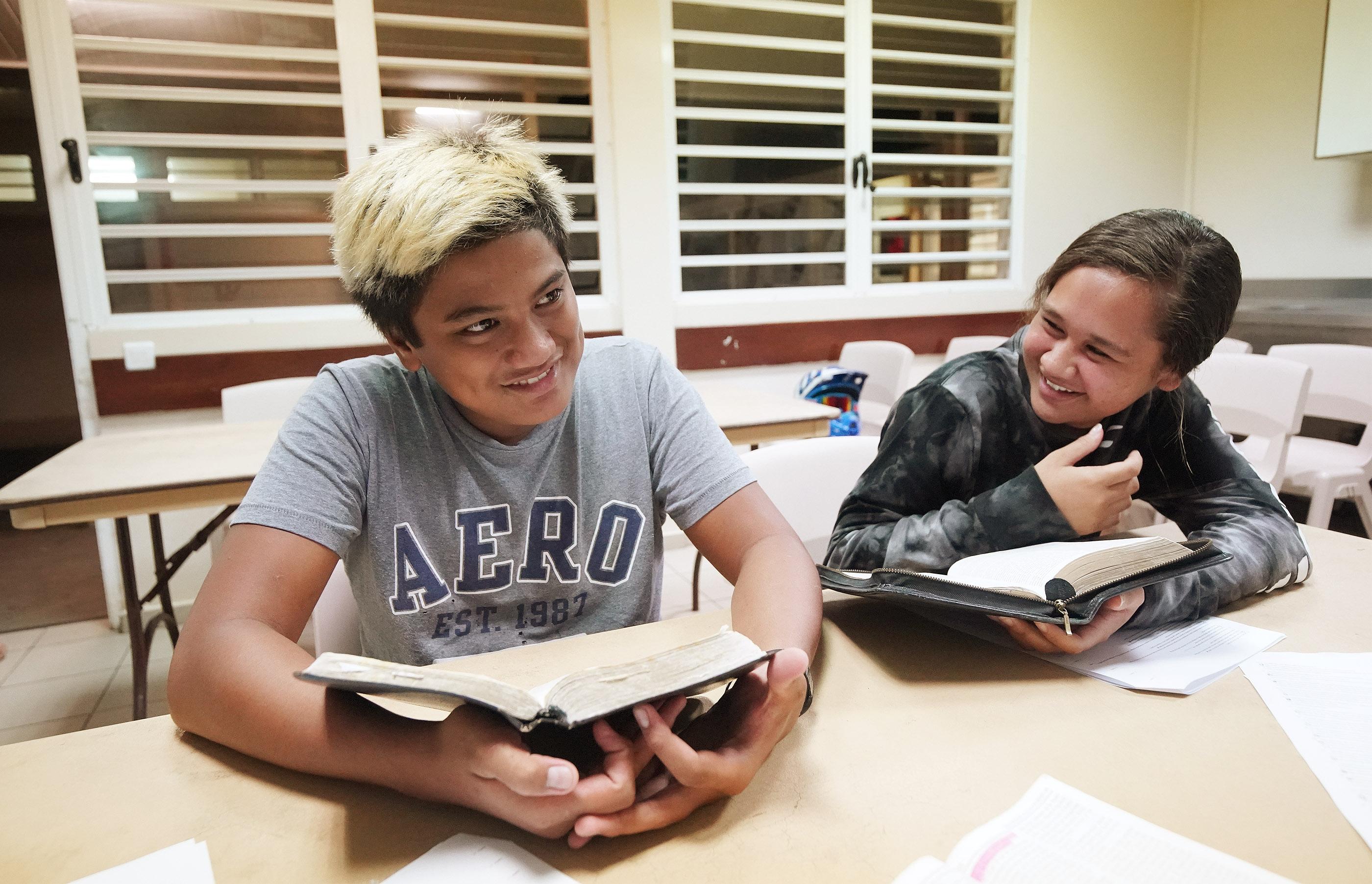 Teharuru Teriipaia and Heraiti Ariiveheata read scriptures during Latter-day Saint seminary in Bora Bora on May 28, 2019.