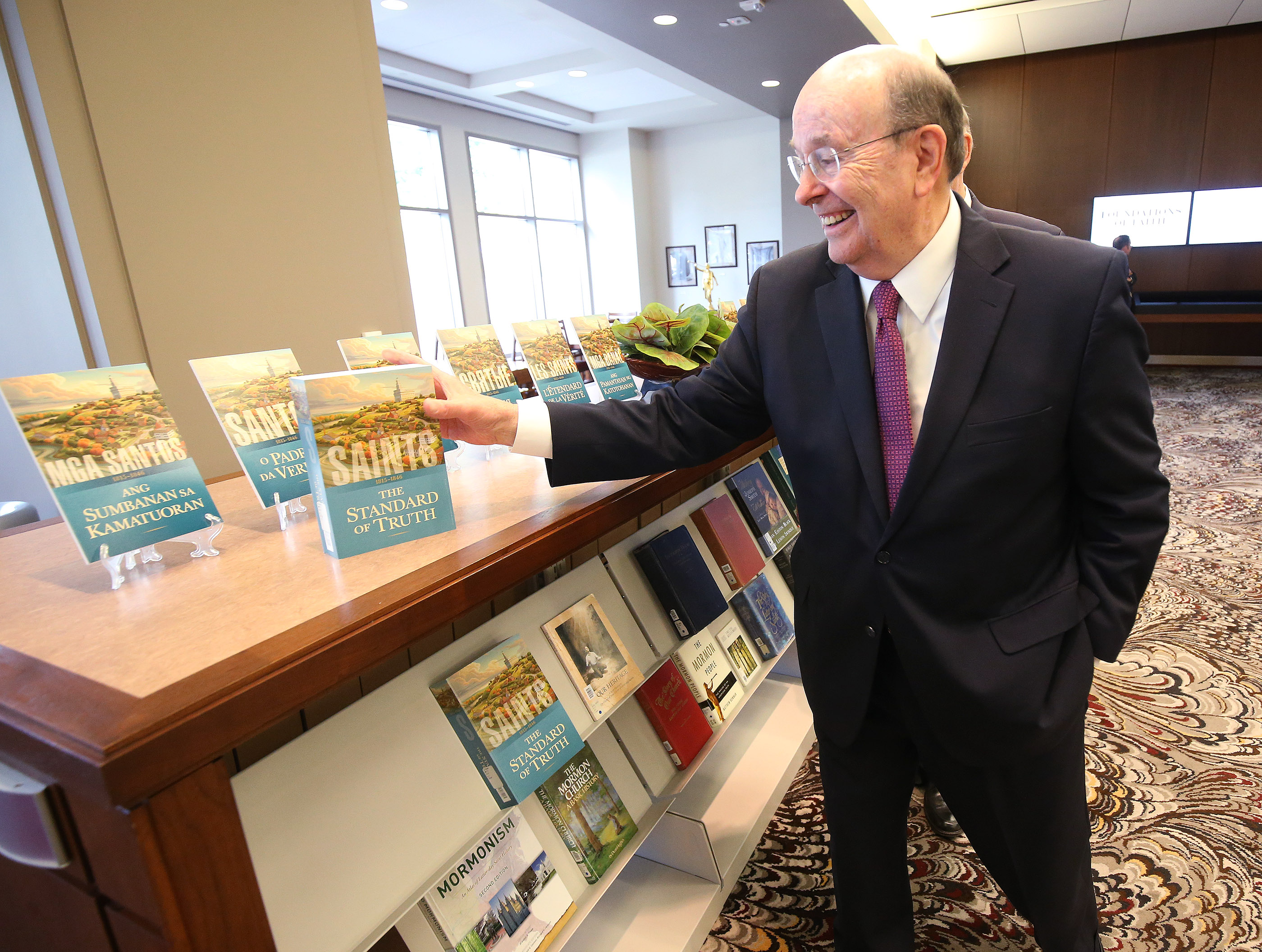 "Elder Quentin L. Cook of the Quorum of the Twelve Apostles looks over ""Saints: The Story of The Church of Jesus Christ in the Latter Days"" in Salt Lake City on Tuesday, Sept. 4, 2018."