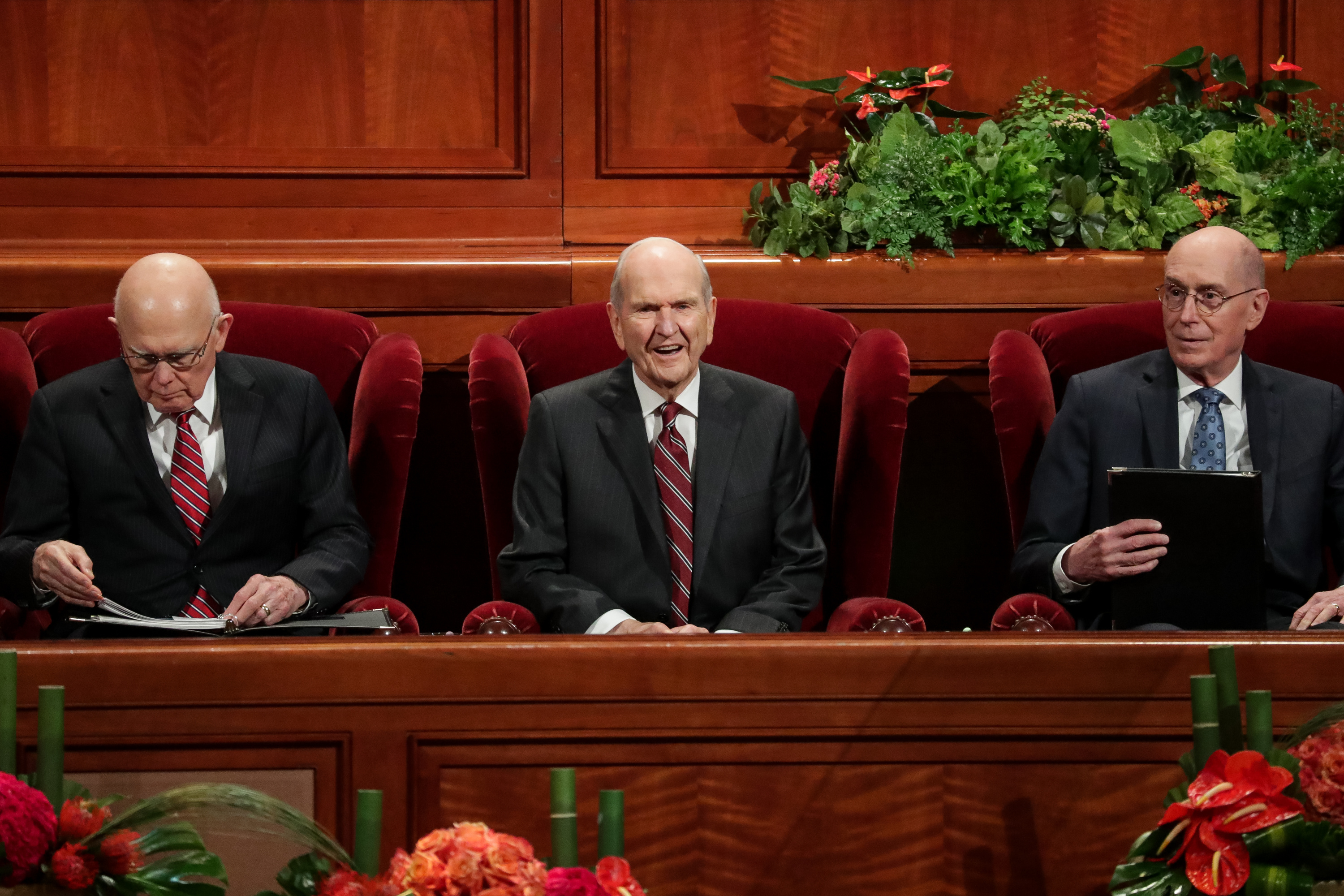 President Russell M. Nelson, center, President Dallin H. Oaks, first counselor, left, and President Henry B. Eyring, second counselor, right, take their seats for the Saturday afternoon session of the 188th Semiannual General Conference of The Church of Jesus Christ of Latter-day Saints in the Conference Center in Salt Lake City on Saturday, Oct. 6, 2018.