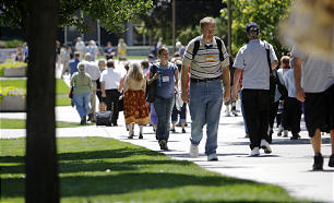 From many states and nations, participants in Campus Education Week walk between classes on BYU's campus in Provo, Utah.