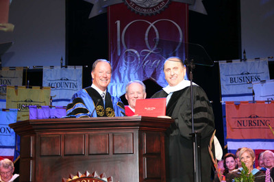 President Thomas S. Monson, right, accepts an honorary doctorate from Dixie State College president Stephen D. Nadauld, center, and State Regent Jerry C. Atkin during the school's May 6, 2011, commencement exercises.
