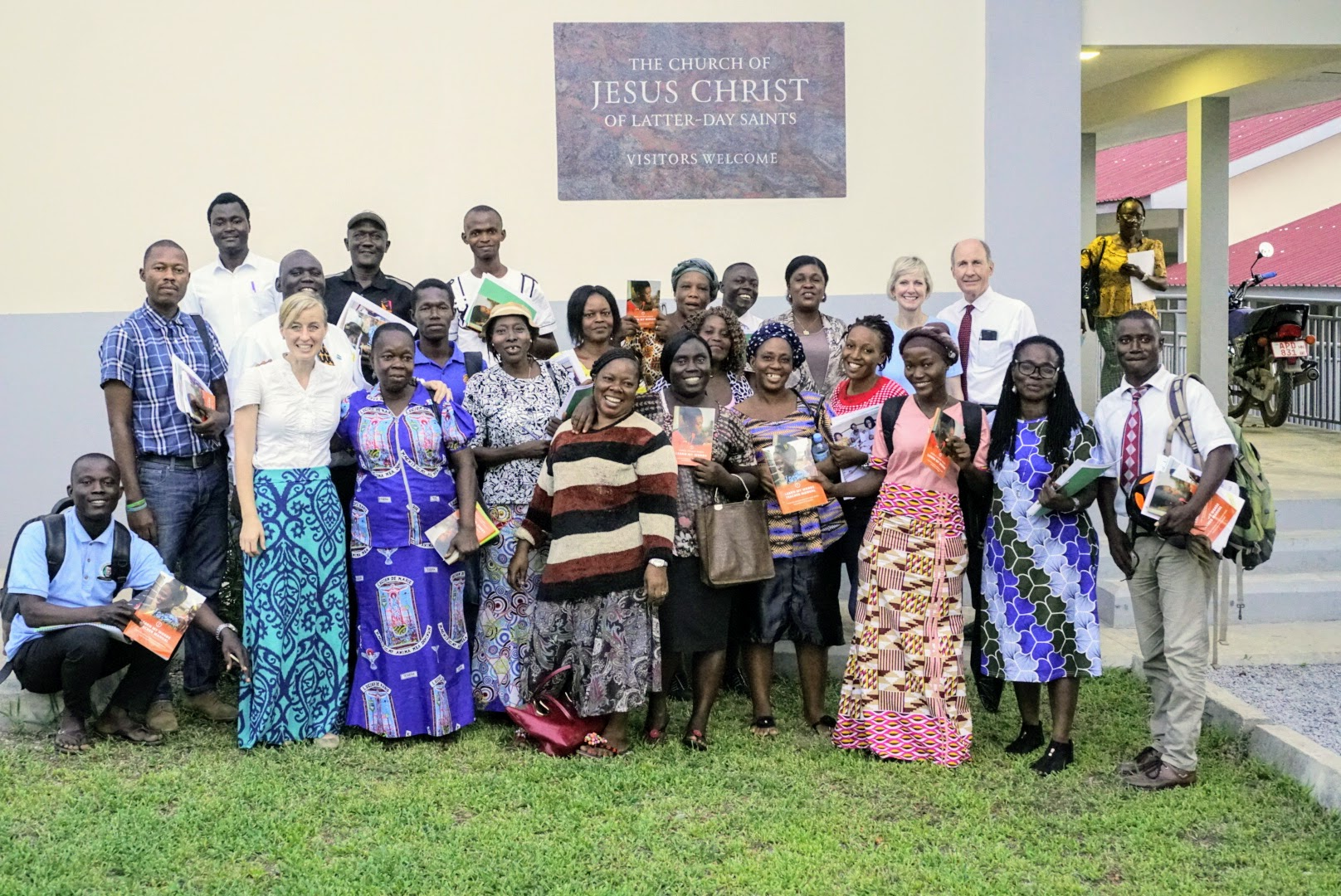 Members pose with Sister Jean B. Bingham after Church in Sierra Leone. Sister Bingham, Relief Society general president, visited the West African country June 5 through June 16, 2019.