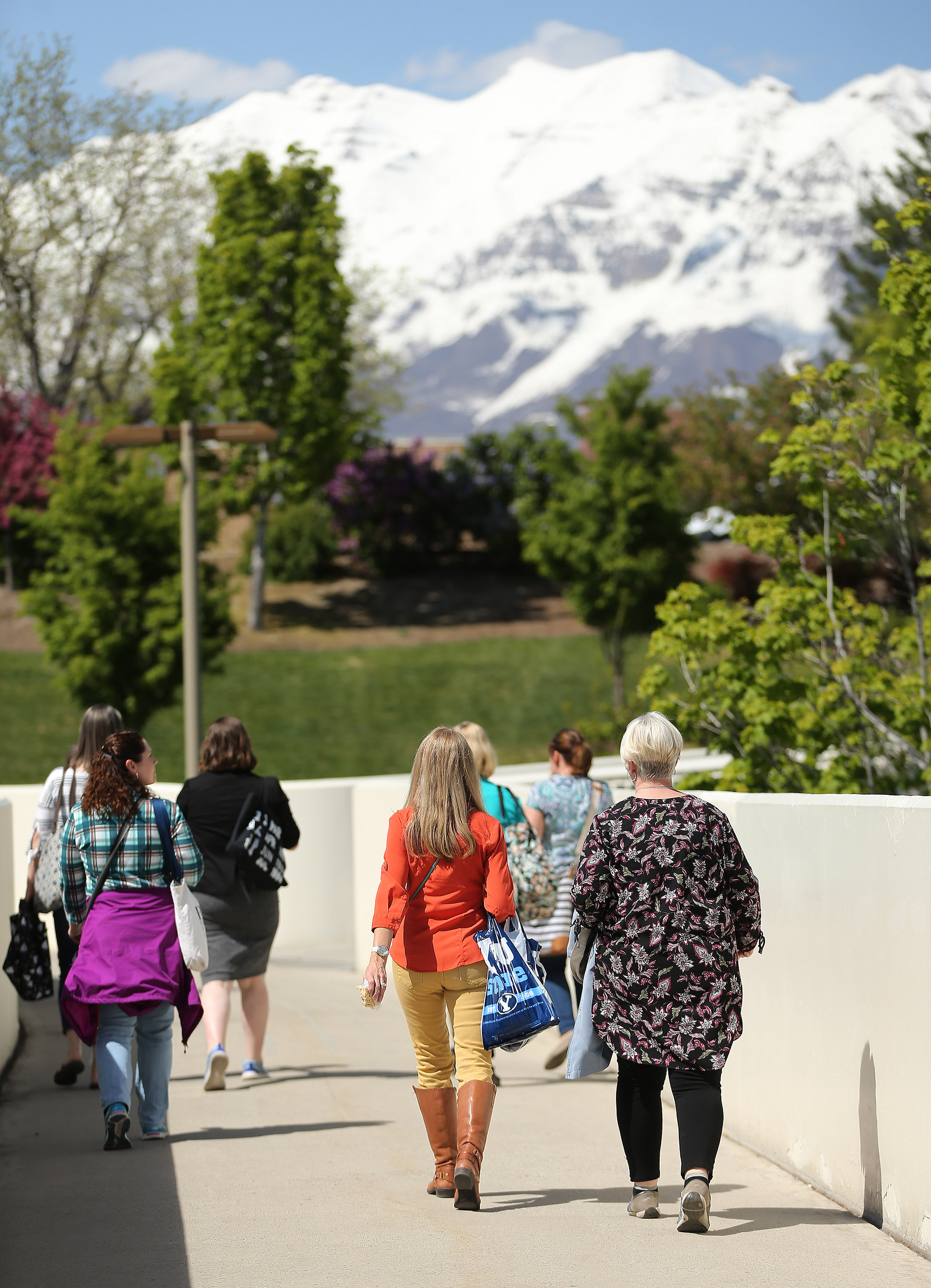Women walk with a view of the mountains during BYU Women's Conference in Provo on Friday, May 3, 2019.