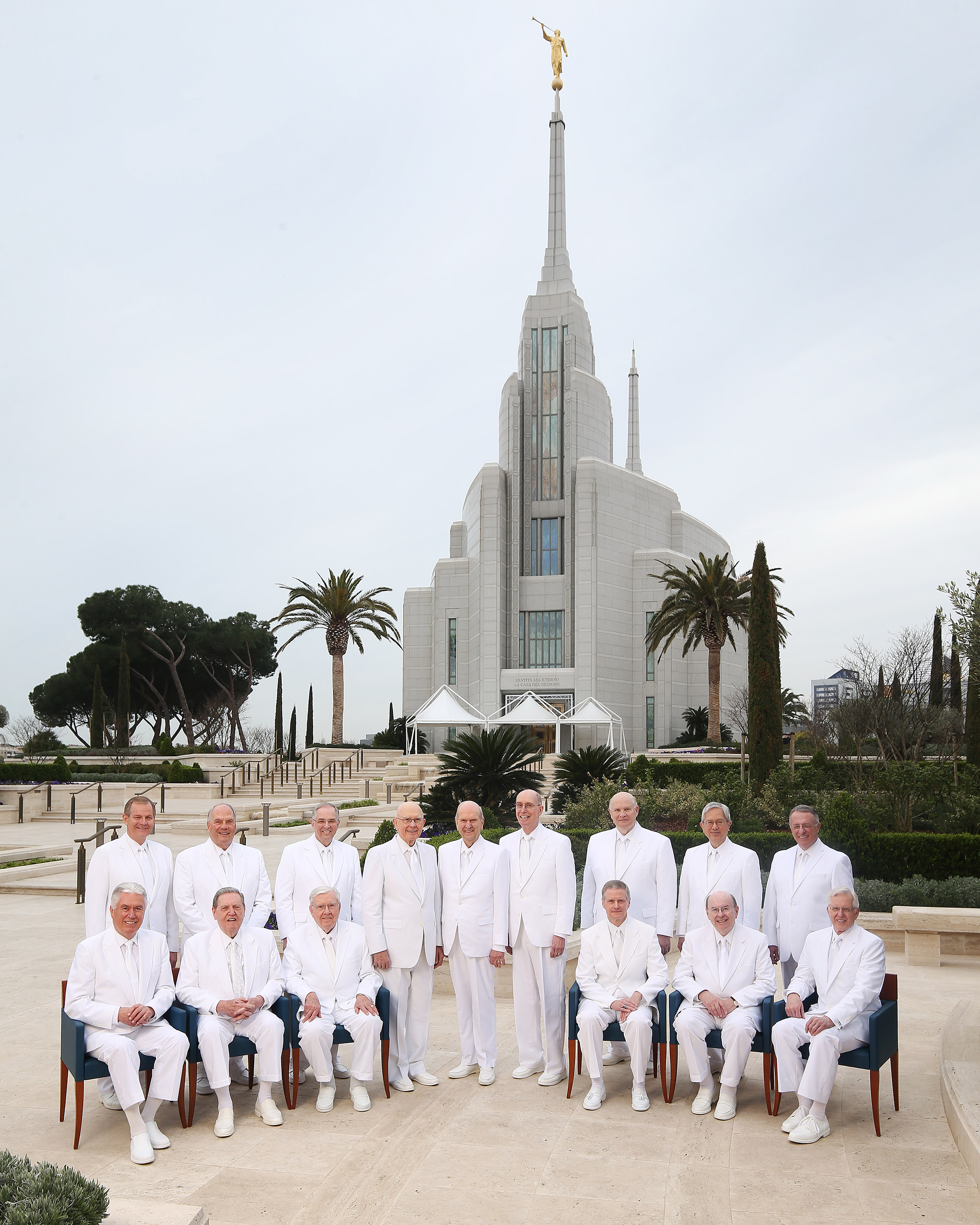 Every member of the First Presidency and the Quorum of the Twelve Apostles of The Church of Jesus Christ of Latter-day Saints, dressed in white temple clothing, pose for an iconic photograph outside the Rome Italy Temple visitors' center in Rome, Italy on Monday, March 11, 2019. Front center are President Russell M. Nelson and his counselors in the First Presidency, President Dallin H. Oaks and President Henry B. Eyring. Also included are members of the Quorum of the Twelve Apostles: President M. Russell Ballard, Elder Jeffrey R. Holland, Elder Dieter F. Uchtdorf, Elder David A. Bednar, Elder Quentin L. Cook, Elder D. Todd Christofferson, Elder Neil L. Andersen, Elder Ronald A. Rasband, Elder Gary E. Stevenson, Elder Dale G. Renlund, Elder Gerrit W. Gong and Elder Ulisses Soares.