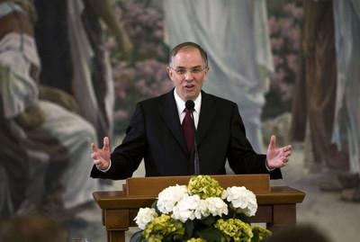 Elder Neil L. Andersen speaks at a news conference.