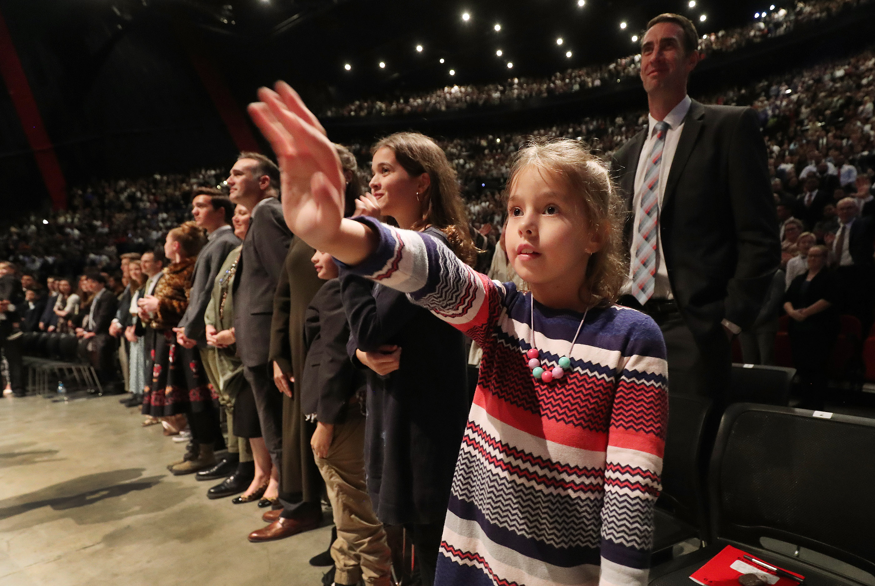 Isla Dunn, 7, waves to President Russell M. Nelson of The Church of Jesus Christ of Latter-day Saints at the International Conference Center on May 19, 2019, in Sydney, Australia.