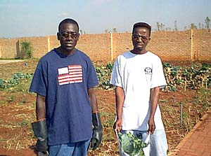 Mwamba Kapema and Brother Maseko at branch garden.