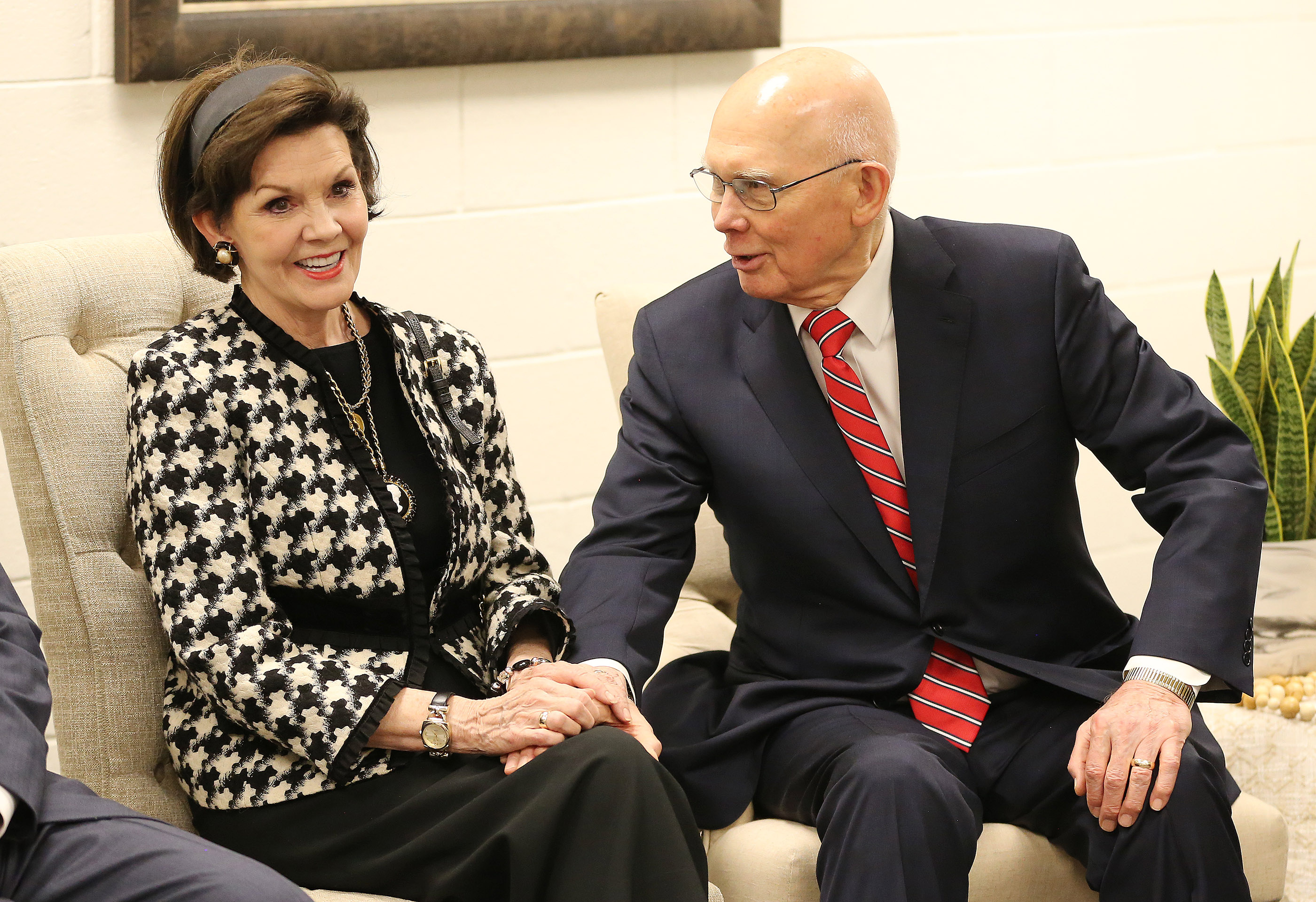 President Dallin H. Oaks, first counselor in the First Presidency of The Church of Jesus Christ of Latter-day Saints, speaks to 10 young single adults with his wife, Sister Kristen Oaks, prior to a devotional at the State Farm Stadium in Phoenix on Sunday, Feb. 10, 2019.