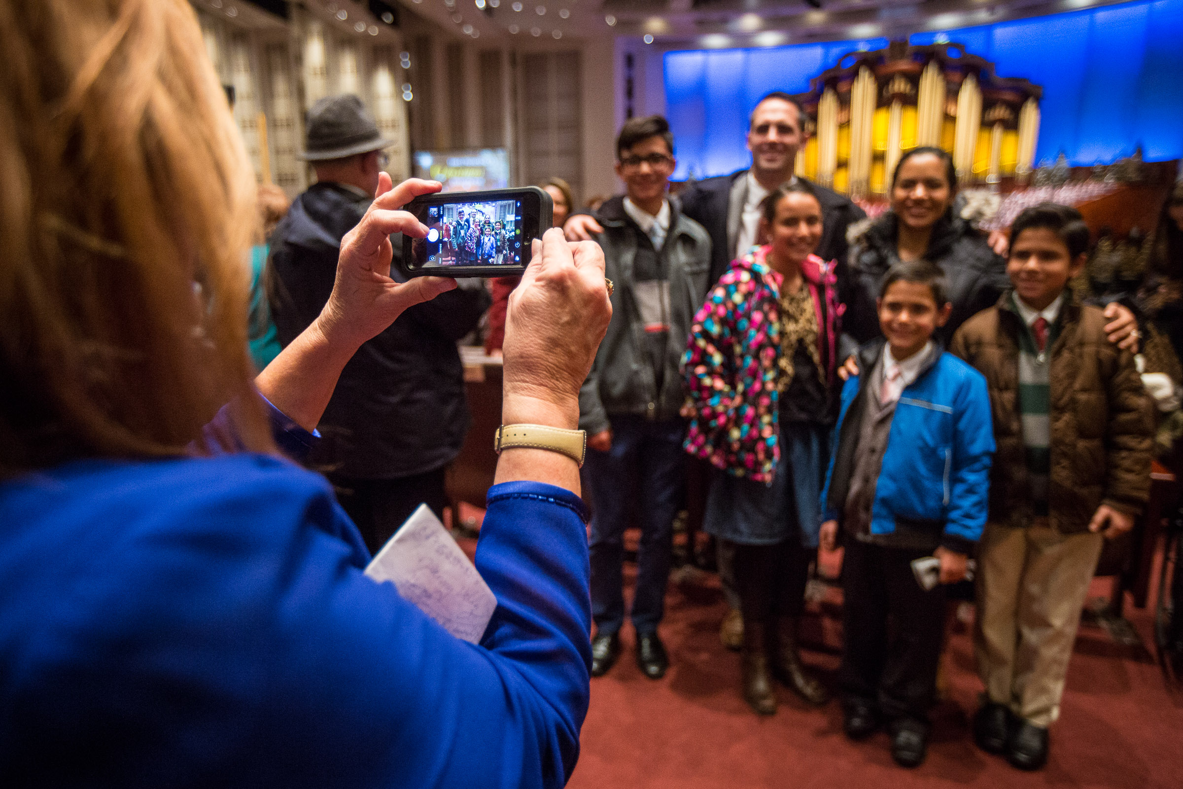 People get their picture taken after the First Presidency's Christmas Devotional in the Conference Center in Salt Lake City on Sunday, Dec. 2, 2018.