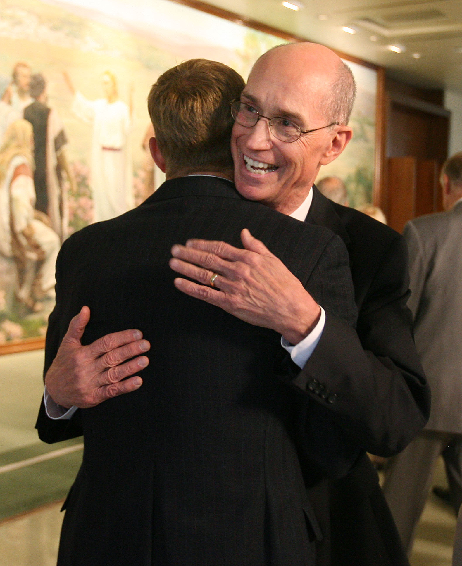 President Henry B. Eyring hugs his son John Eyring after a press conference between sessions of LDS General Conference Oct 6, 2007 in Salt Lake City.