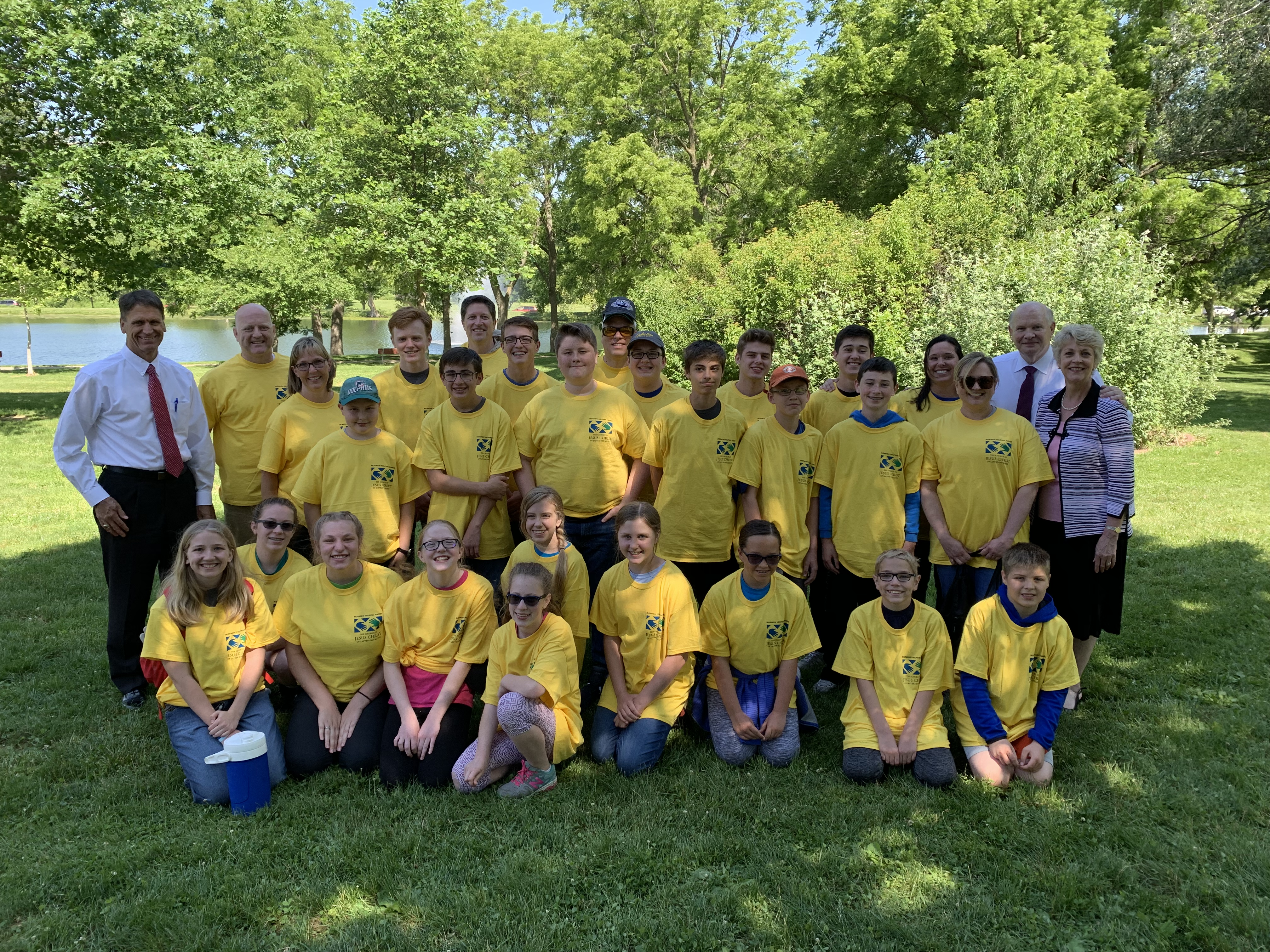 Elder Dale G. Renlund, Sister Ruth Renlund and Elder Carl B. Cook with youth and leaders who came to serve the Iowa flood victims on June 10, 2019.