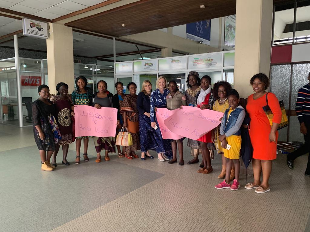 Women in Beira, Mozambique, greet Sister Bonnie H. Cordon, Young Women general president, at the Beira International Airport by singing as she walked out.
