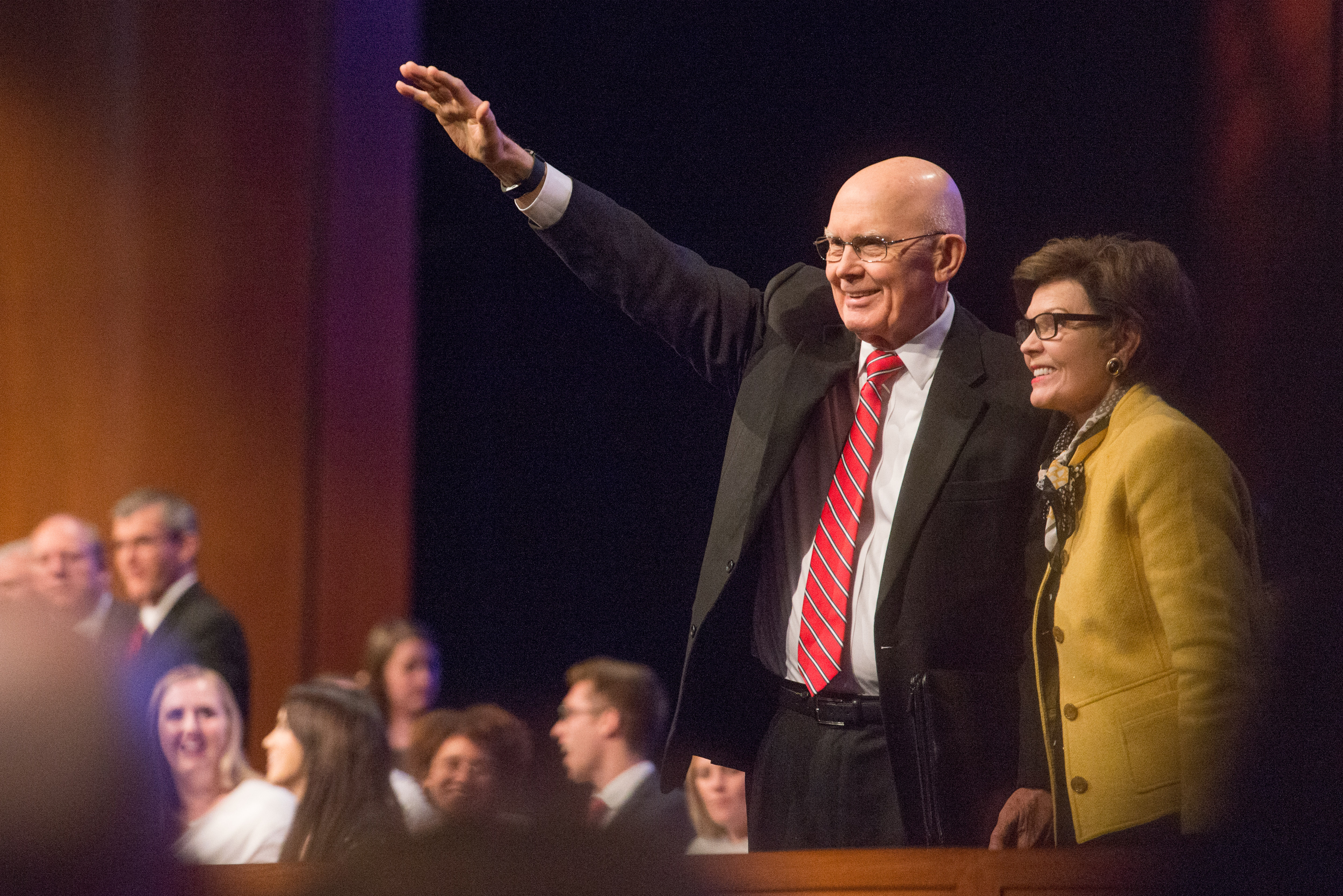 President Dallin H. Oaks of the First Presidency and his wife, Sister Kristen M. Oaks, wave to students at a BYU-Idaho campus devotional on Oct. 30.