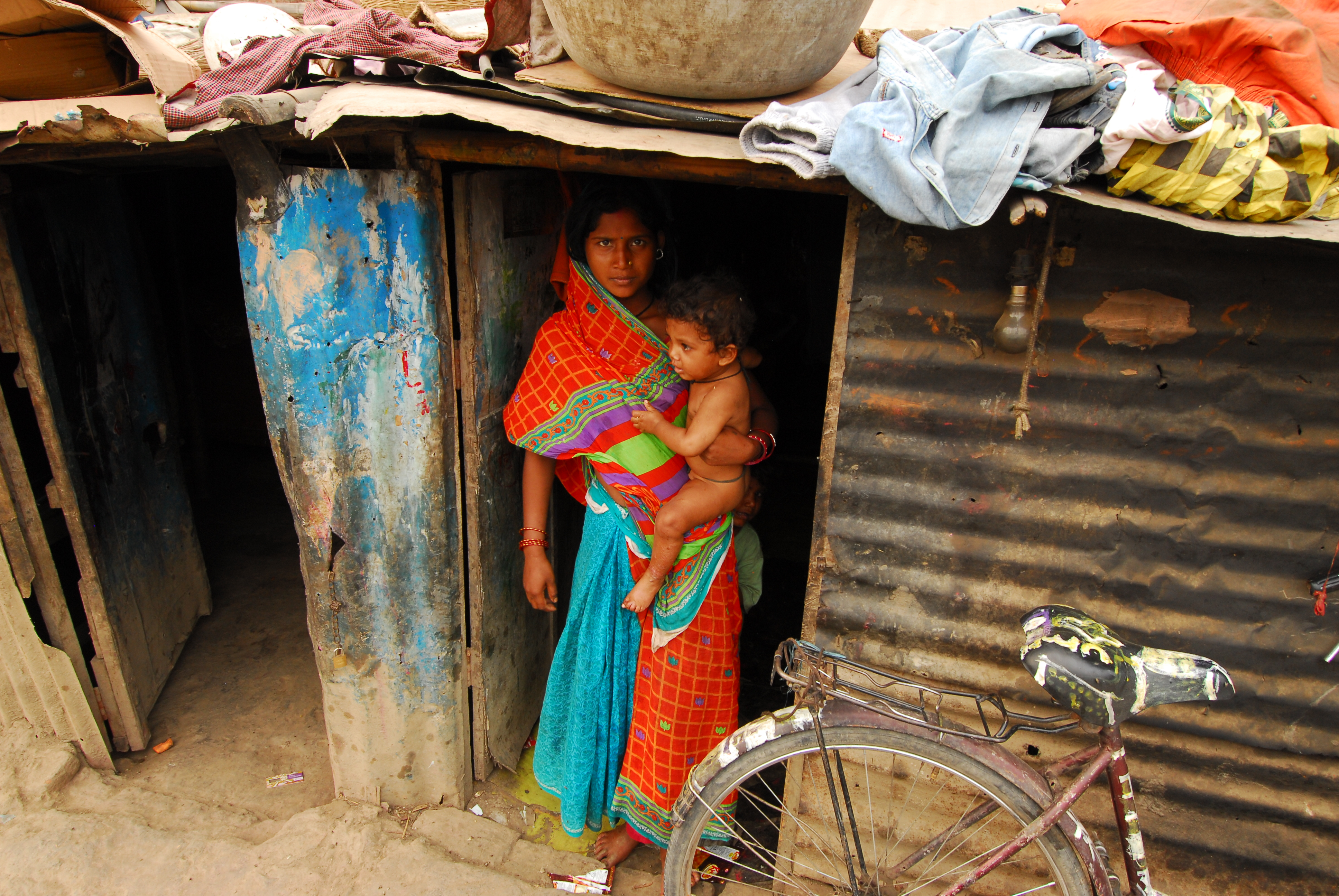 Young mothers in the slums near Chitwan are often lacking any formal education.