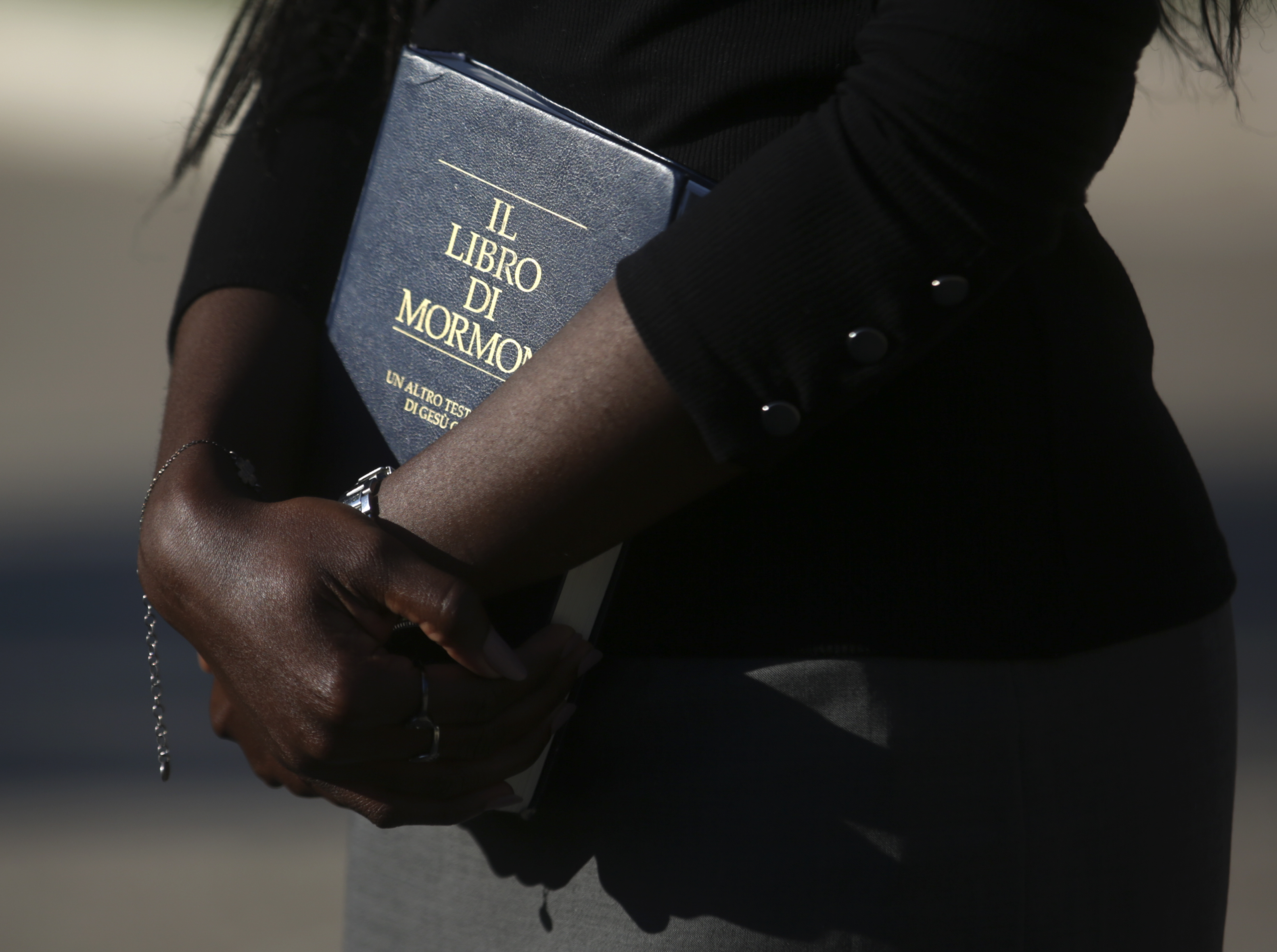 Sister Carolyne Dwomoh holds an Italian Book of Mormon while finding in Rome, Italy, on Saturday, Nov. 17, 2018.