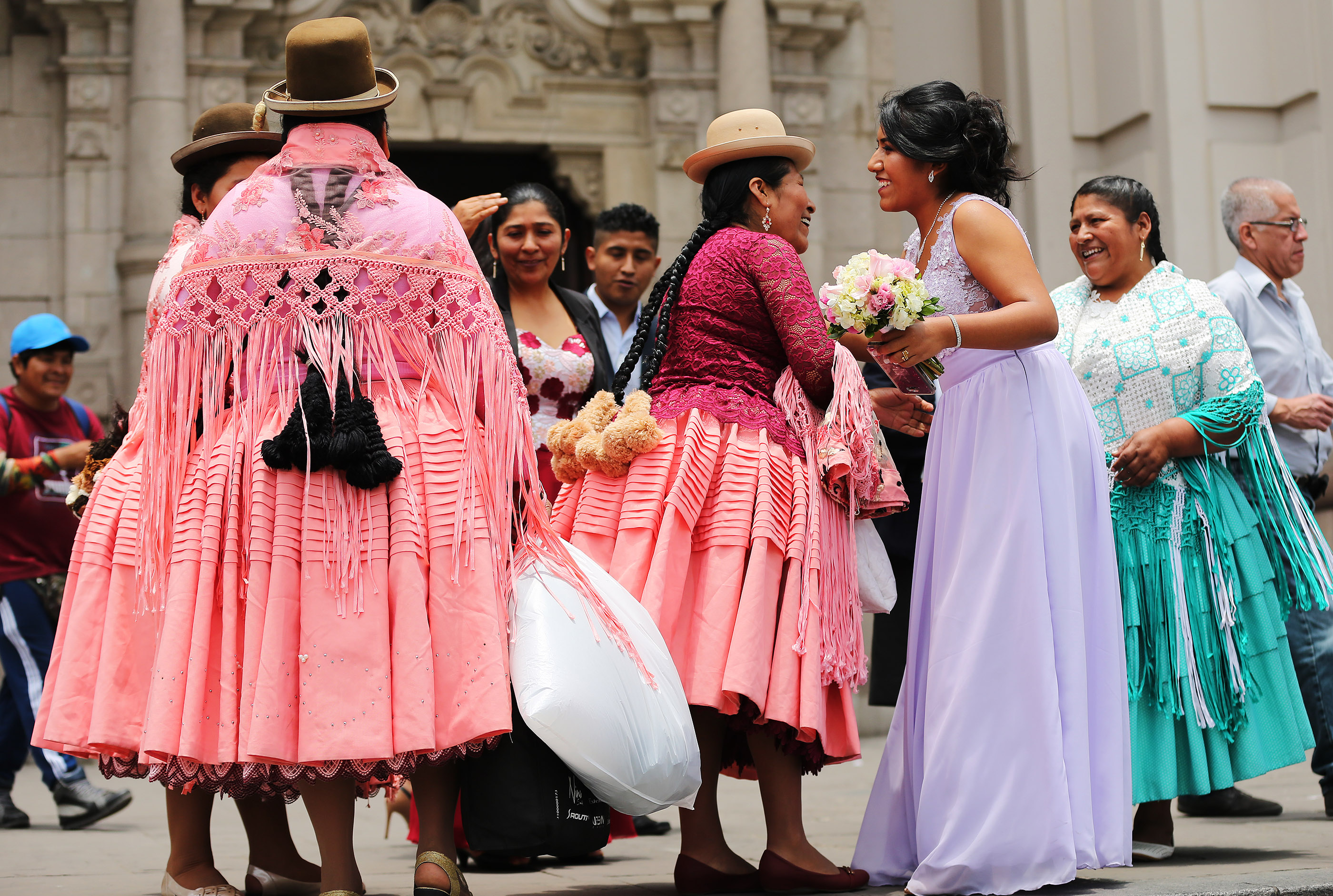 A Peruvian bride greets family and friends at the Basilica Cathedral of Lima in Lima, Peru, on Oct. 21, 2018.