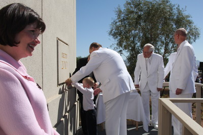 Hunter Reidhead, 5, of the Pomerene Ward, St. David Arizona Stake, applies mortar to The Gila Valley Arizona Temple cornerstone with the help of President Thomas S. Monson.