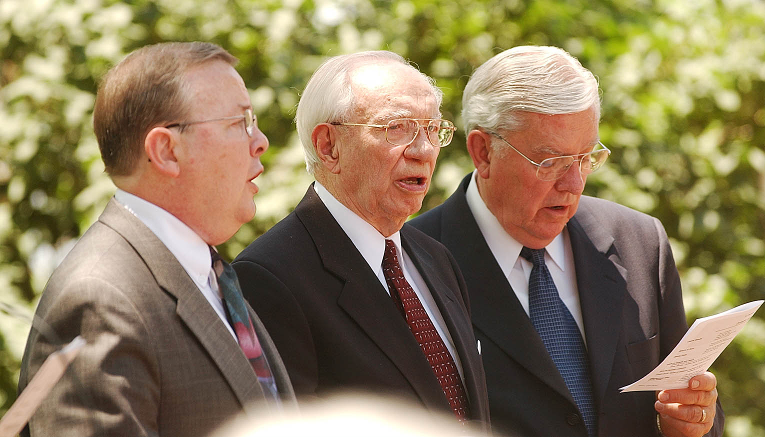 Community of Christ Pres Grant McMurray, President Gordon B. Hinckley, and Elder President M. Russell Ballard sing during the Joseph and Hyrum Smith commemoration service June 27th, 2002.