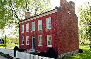 Home of Wilford Woodruff, as cast against setting sun, is excellect example of a well-preserved Nauvoo-era home.