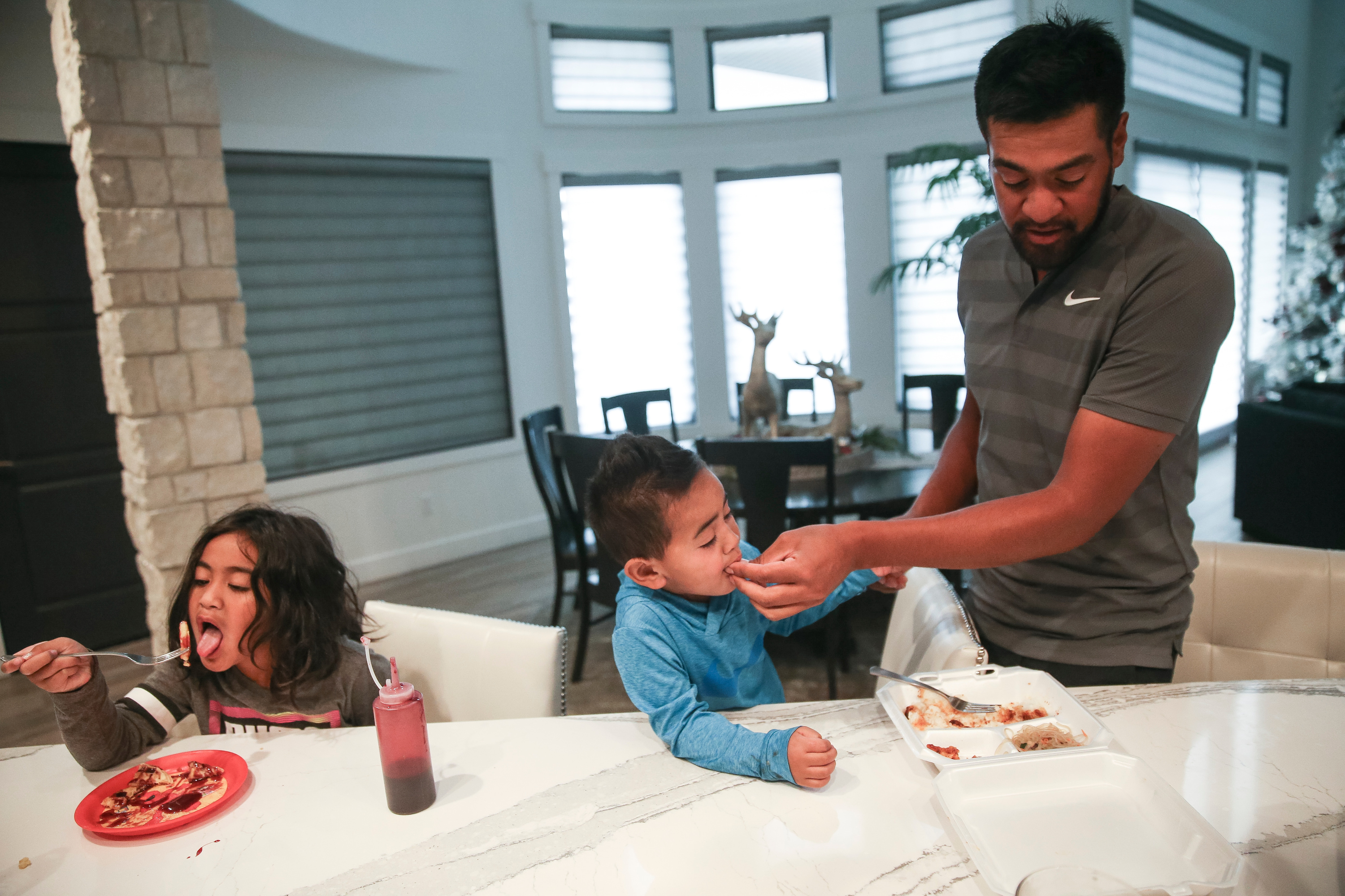 PGA golfer Tony Finau eats with two of his children, Sage, 1, and Tony, 2, at their home in Lehi on Tuesday, Feb. 6, 2018.