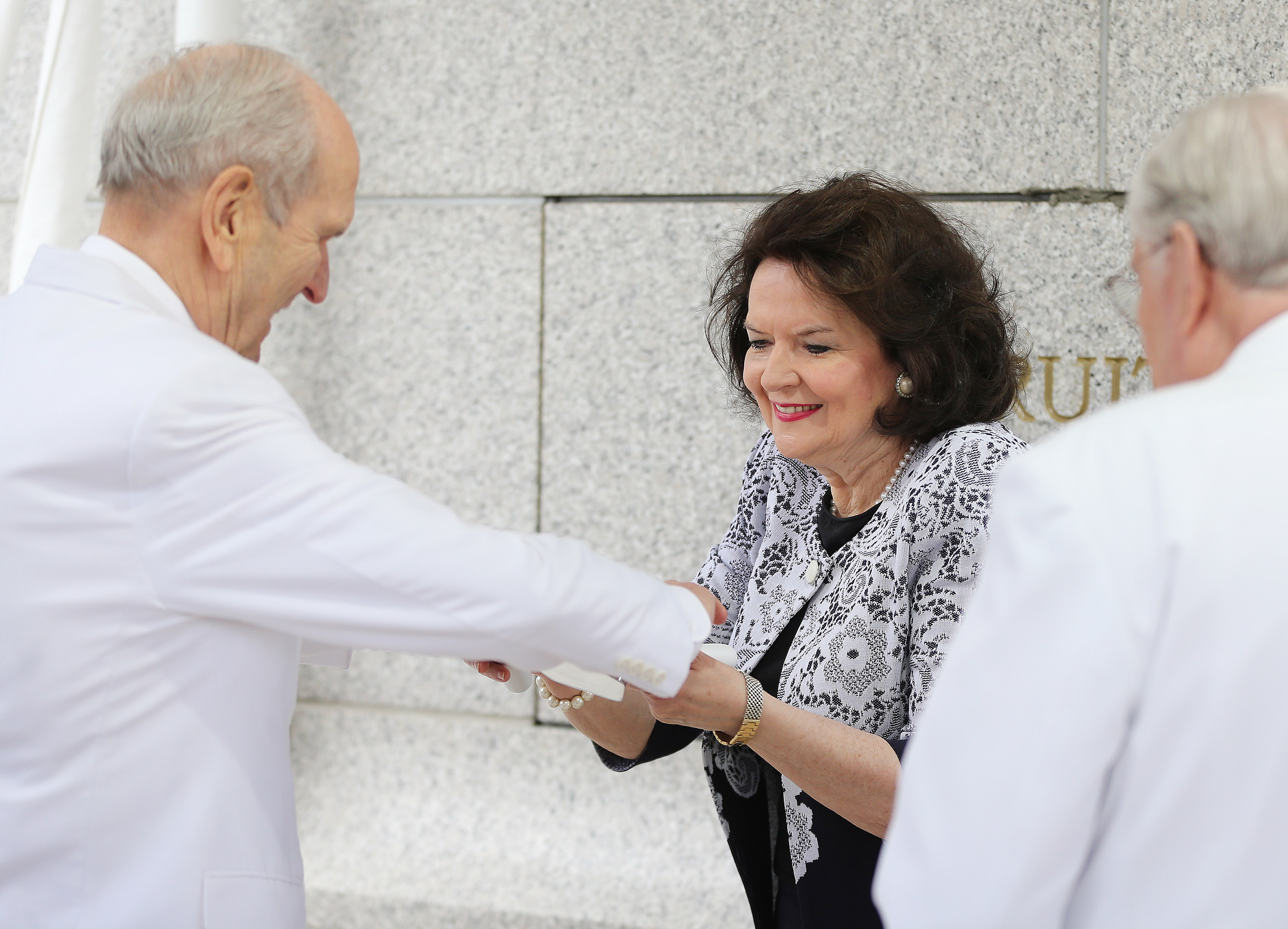 President Russell M. Nelson of The Church of Jesus Christ of Latter-day Saints and his wife, Sister Wendy Nelson, place mortar during the cornerstone ceremony of the dedication of the Rome Italy Temple of The Church of Jesus Christ of Latter-day Saints in Rome, Italy, on Sunday, March 10, 2019.