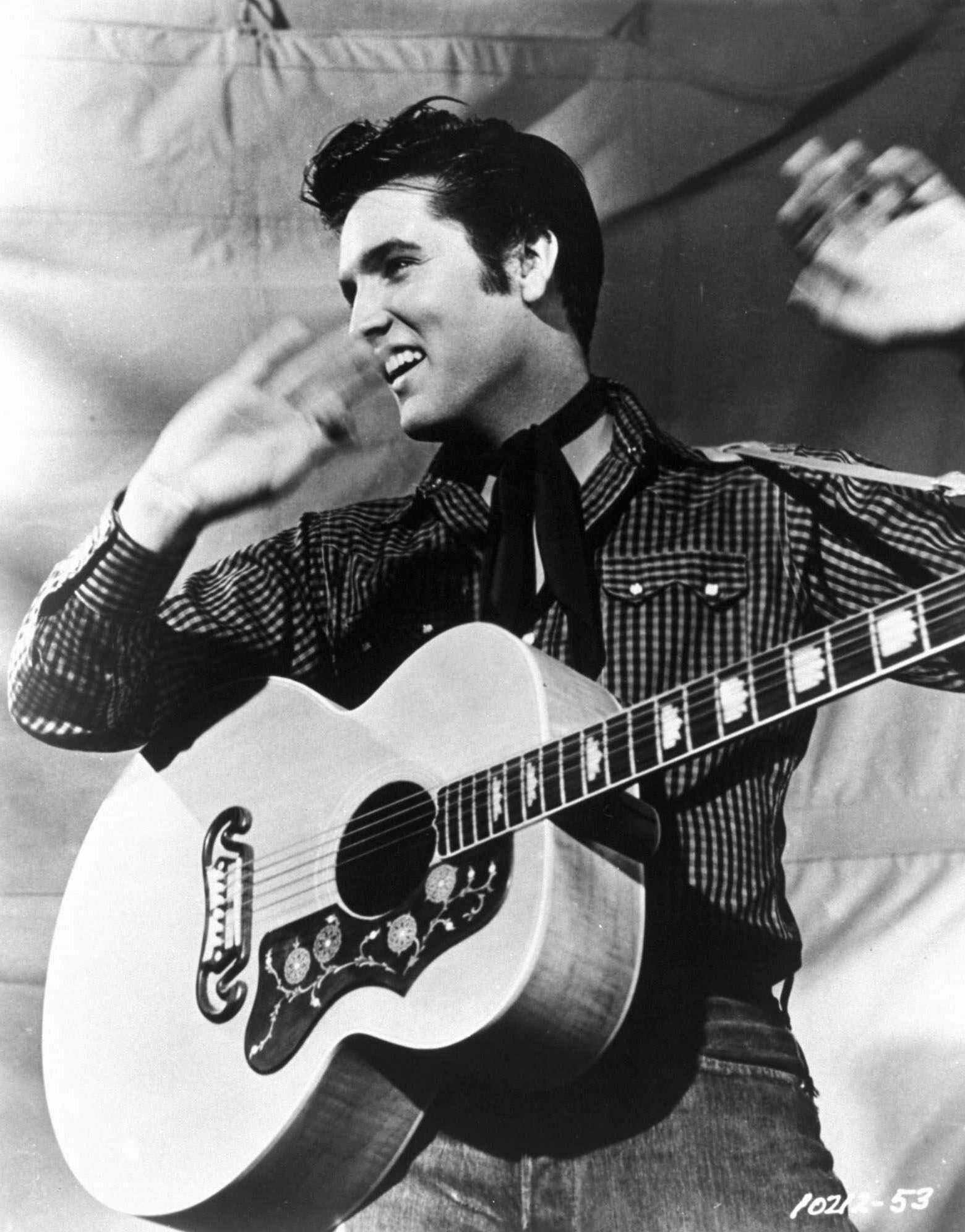 "FILE--Elvis Presley is shown with his Gibson J-200 guitar in this 1957 MGM handout file photo. Presley fans in Japan will soon get to hear a collection of standards picked by the nation's wildly popular prime minister, Junichiro Koizumi. ""Junichiro Koizumi Presents: My Favorite Elvis Songs'' will hit Japanese record shops Wednesday, Aug. 22, 2001, said Katsumi Miyata, a spokesman for BMG Funhouse Inc., a subsidiary for international music company BMG."