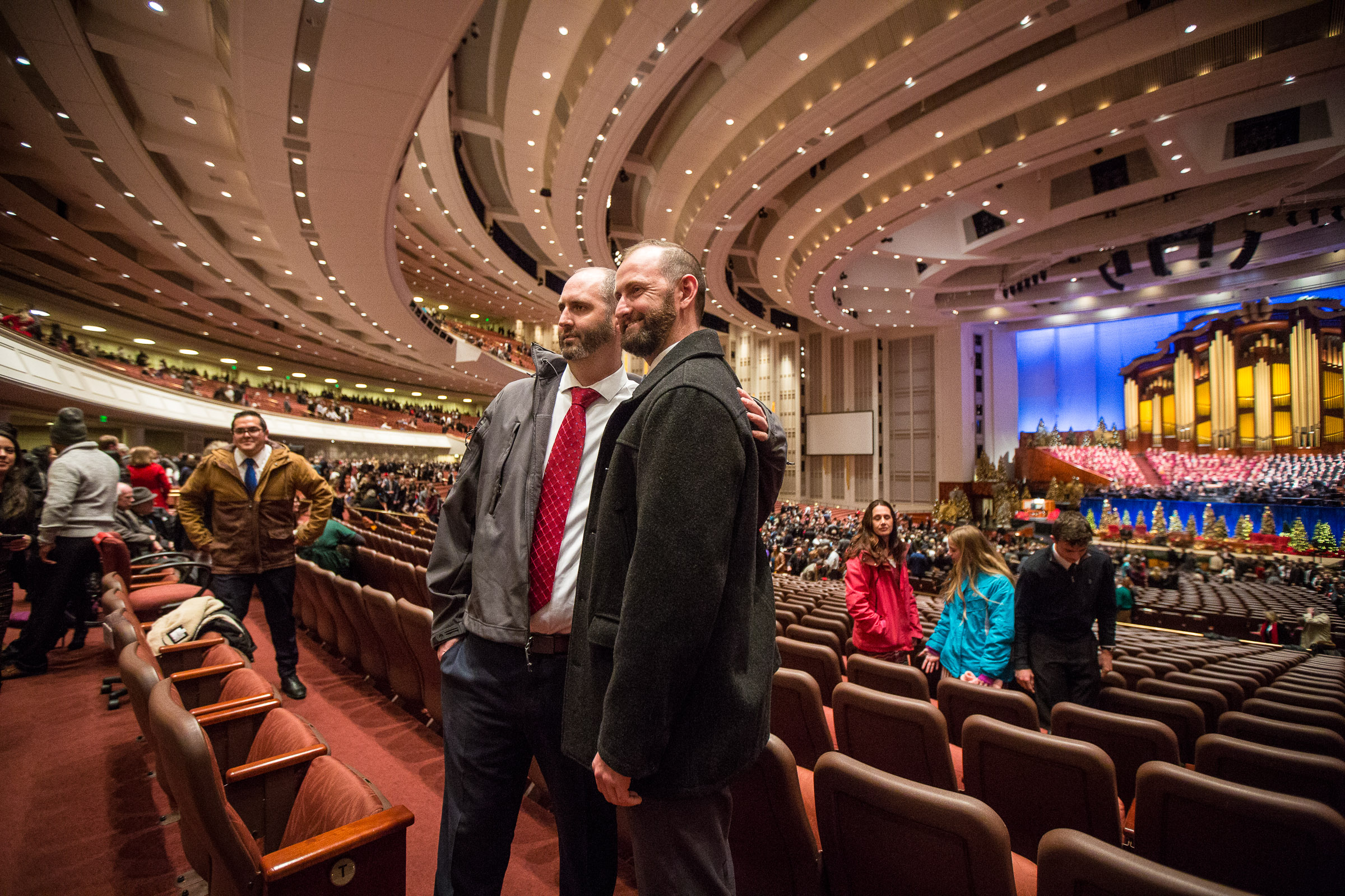 Derek Lemon, left, and Patrick Lemon get their picture taken after the First Presidency's Christmas Devotional in Conference Center in Salt Lake City on Sunday, Dec. 2, 2018.