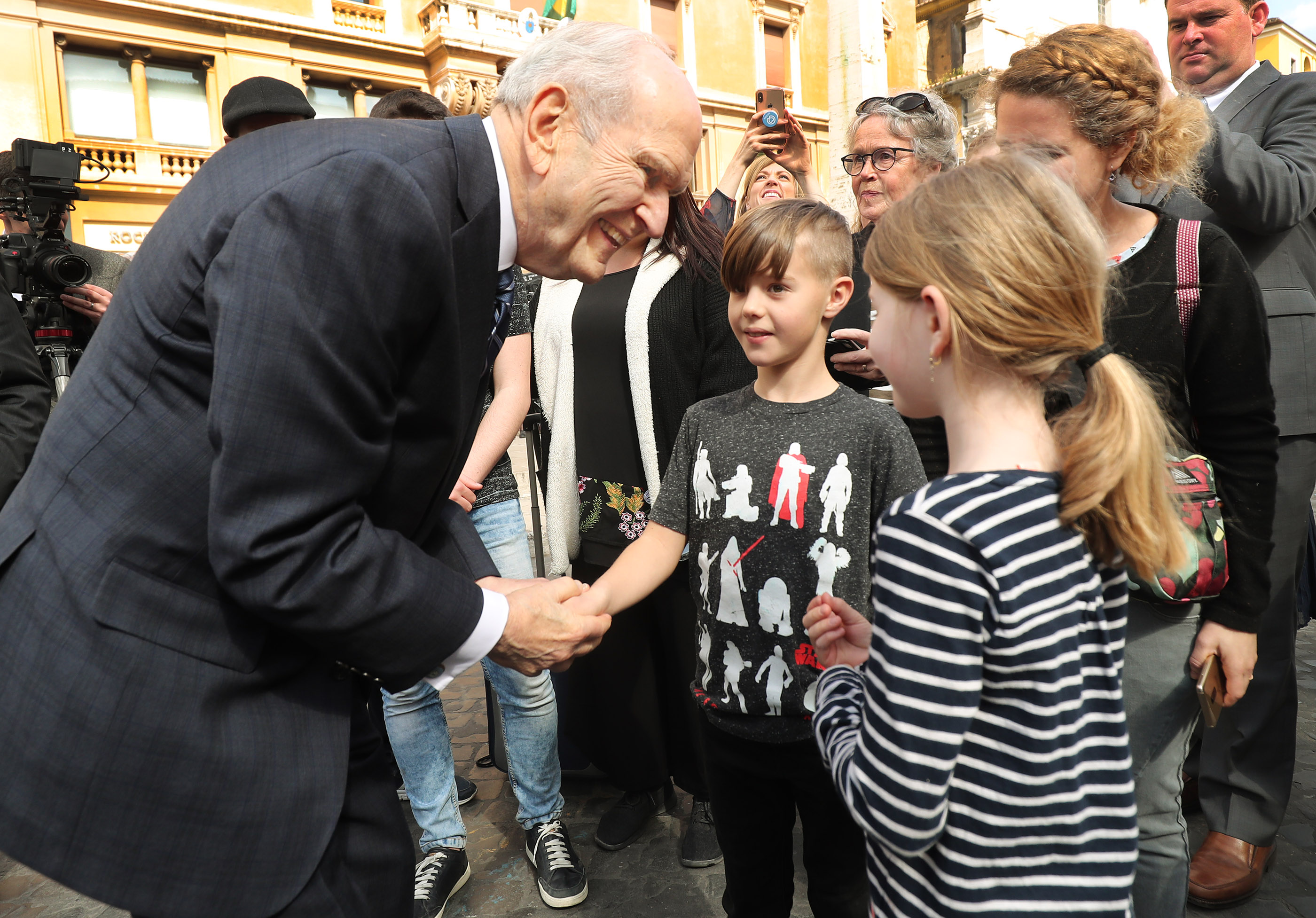 President Russell M. Nelson of The Church of Jesus Christ of Latter-day Saints pauses to talk with Ammon and Emma Schar, of Basel, Switzerland, in Rome, Italy, on Saturday, March 9, 2019. The Schar family is in Rome for the temple dedication.