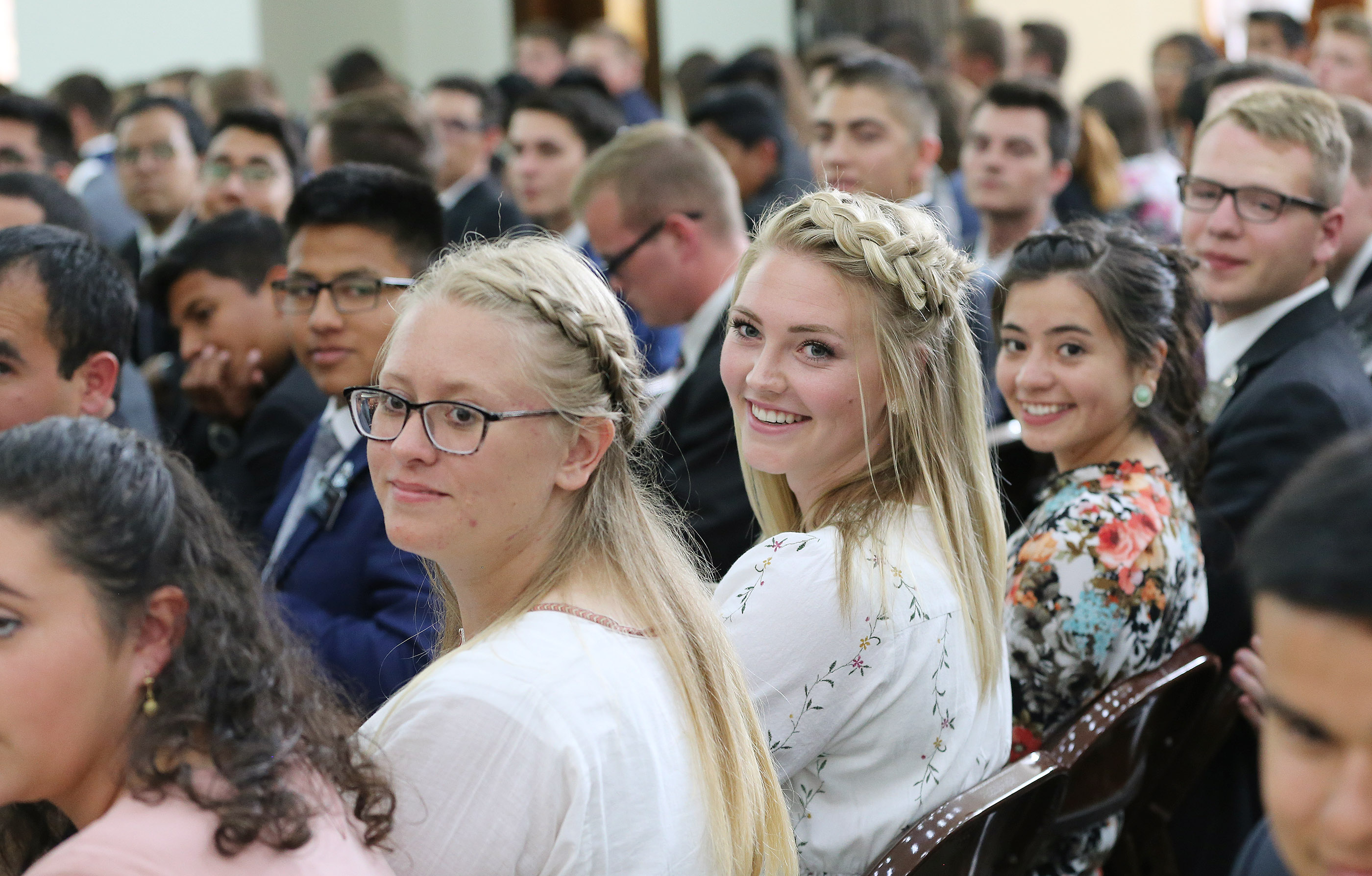 Missionaries watch President Russell M. Nelson of The Church of Jesus Christ of Latter-day Saints prior to a missionary meeting in Montevideo, Uraguay on Thursday, Oct. 25, 2018. The First Presidency of the Church of Jesus Christ of Latter-day Saints announced Friday, Feb. 15, that missionaries worldwide are now authorized to communicate with their families each week on preparation day by text messages, online messaging, phone calls and video chats, in addition to letters and emails.