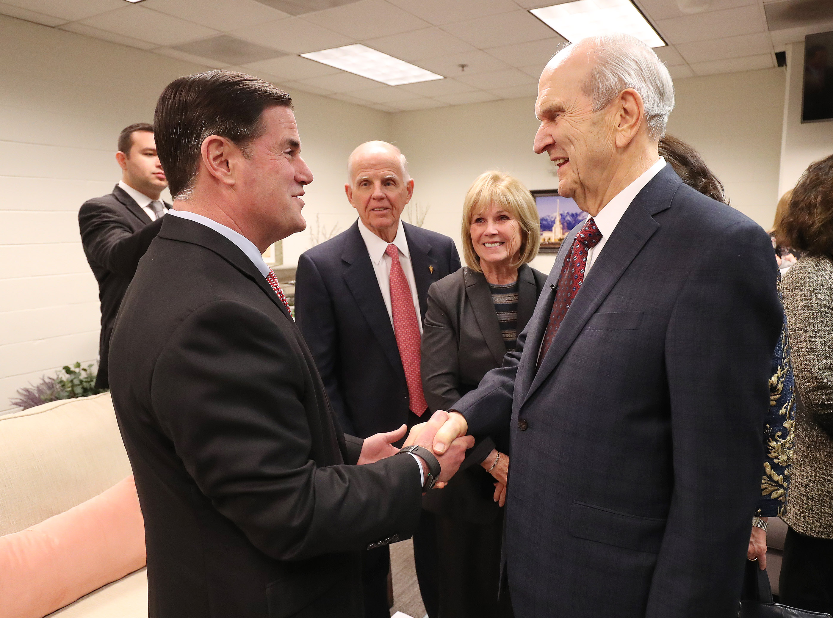 President Russell M. Nelson of The Church of Jesus Christ of Latter-day Saints, right, meets Arizona Gov. Doug Ducey prior to a devotional at the State Farm Stadium in Phoenix on Sunday, Feb. 10, 2019.