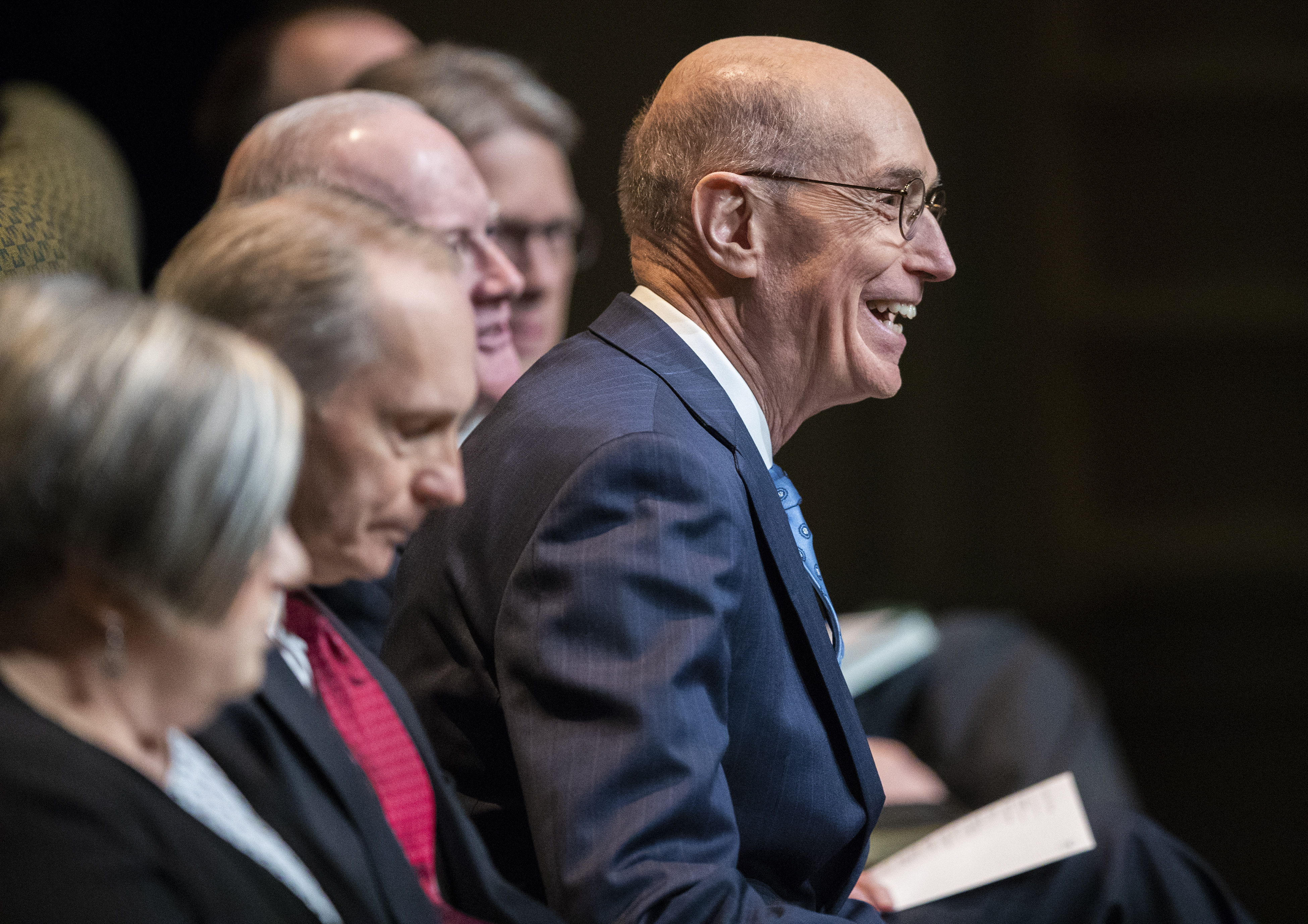 President Henry B. Eyring smiles at the audience as he takes his seat prior to speaking to LDS Business College students during a devotional in the Conference Center theater in Salt Lake City on Tuesday, Nov. 6, 2018.