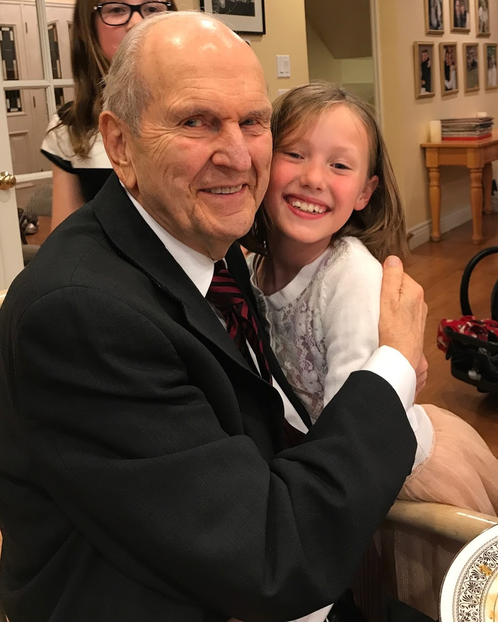 President Russell M. Nelson with a granddaughter.
