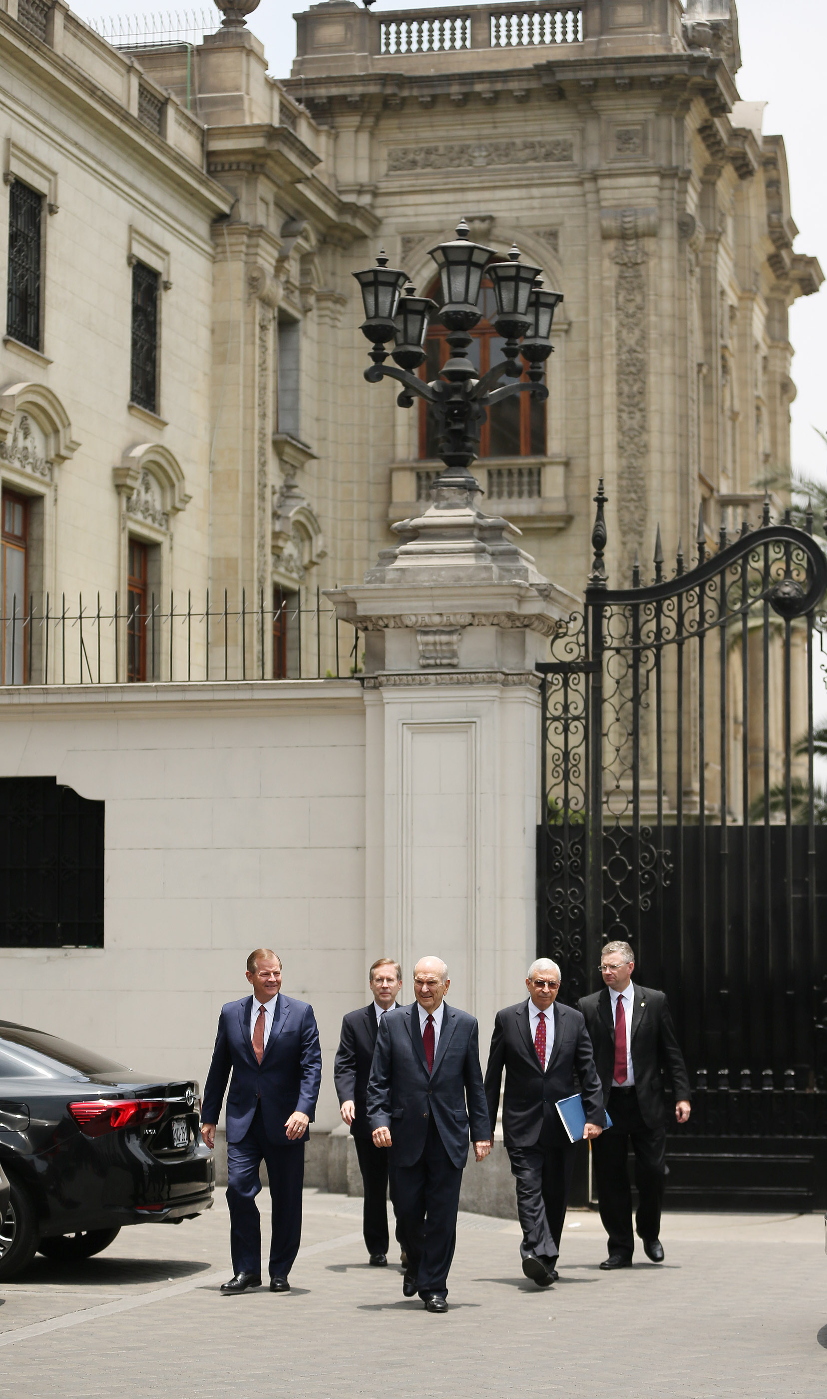 President Russell M. Nelson of The Church of Jesus Christ of Latter-day Saints, center, Elder Gary E. Stevenson, of the Quorum of the Twelve Apostles, and Elder Enrique Falabella, General Authority Seventy, leave the Government Palace after speaking with the president of Peru in Lima on Oct. 20, 2018.