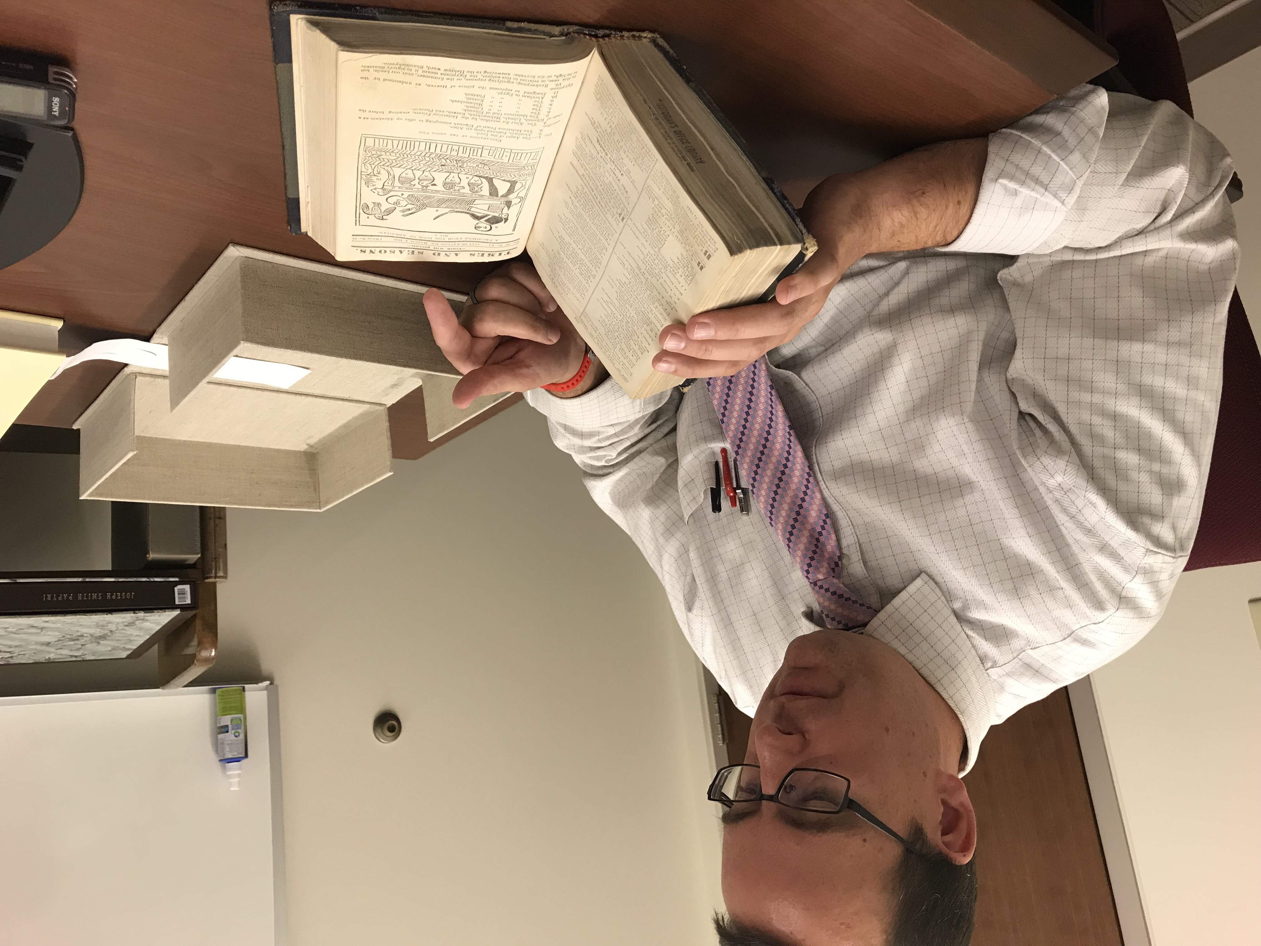 Robin Jensen, a volume editor, shows a copy of the 1842 Times and Seasons with a facsimile from the Book of Abraham.