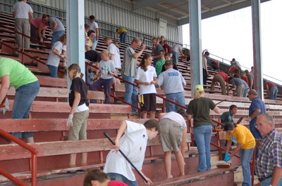 Youth and leaders from the Chubbuck Idaho Stake gather at the Bannock County Fairgrounds in Pocatello, Idaho, to re-paint the bleachers in preparation for the upcoming Pioneer Day celebration on July 18. In an hour and a half the group used 50 gallons of paint and nearly finished the 2,000 feet of grandstands.