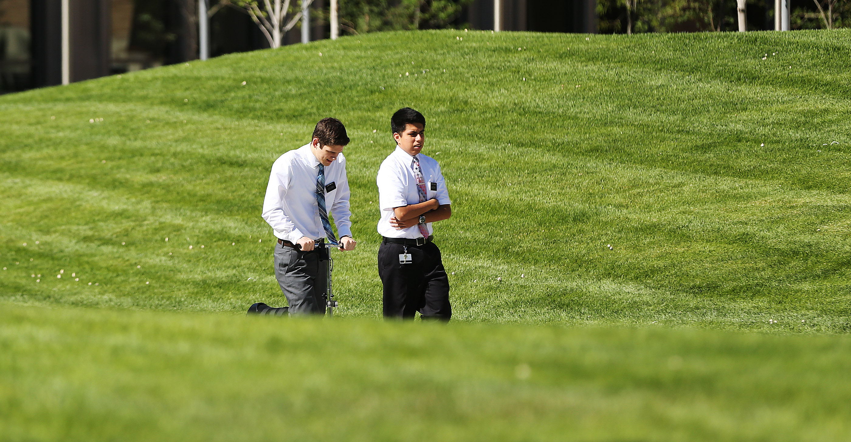 Missionaries walk the grounds of the Provo Missionary Training Center in Provo on Wednesday, July 26, 2017.